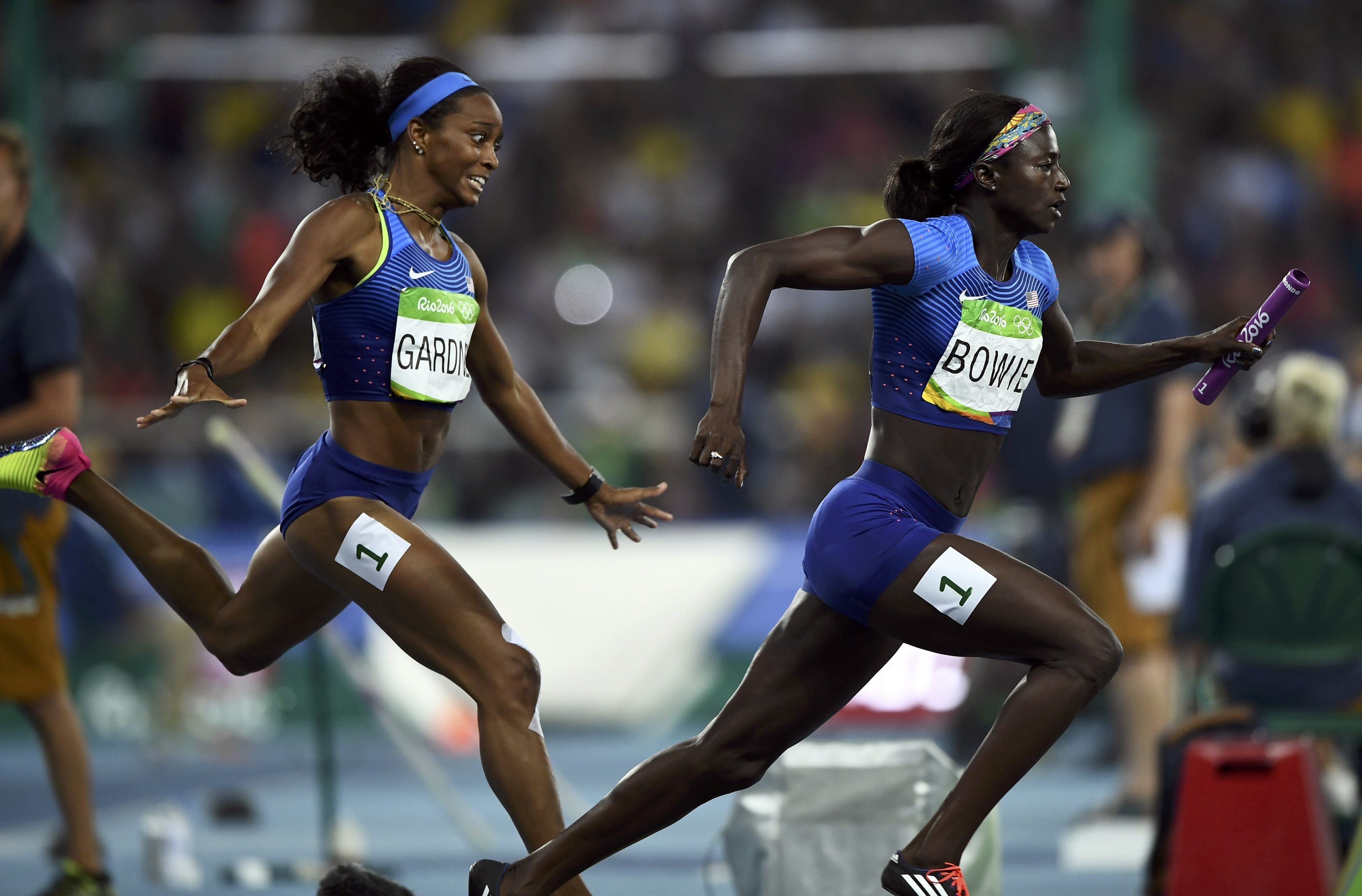 United States' English Gardner hands the baton to anchor Tori Bowie during the women's 4x100-meter relay final at the Rio de Janairo Olympics on Friday. The team won the gold medal for the second straight Summer Games.   | REUTERS