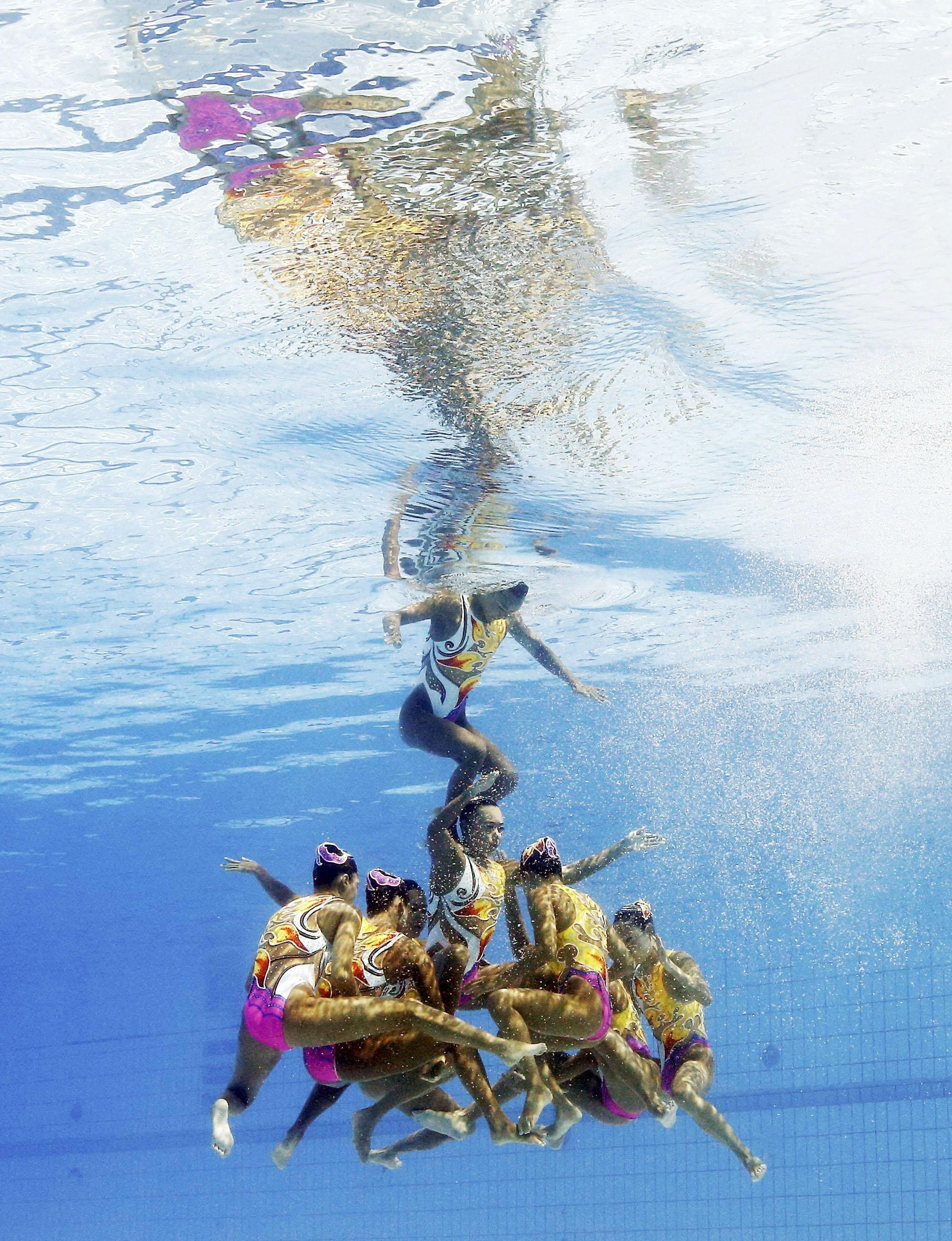 Japanese synchro swimmers perform during Friday's team competition at the Rio Games. They captured the bronze medal. | KYODO VIA REUTERS