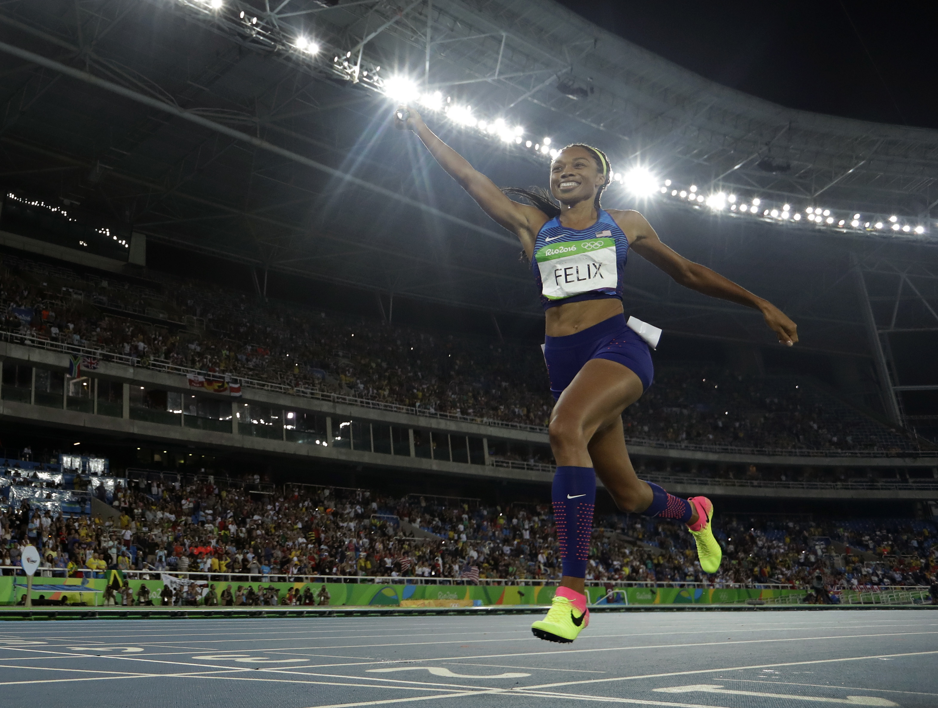 The United States' Allyson Felix crosses the line to capture the gold medal in the women's 4x400-meter final on Saturday at the 2016 Rio Olympics. | AP