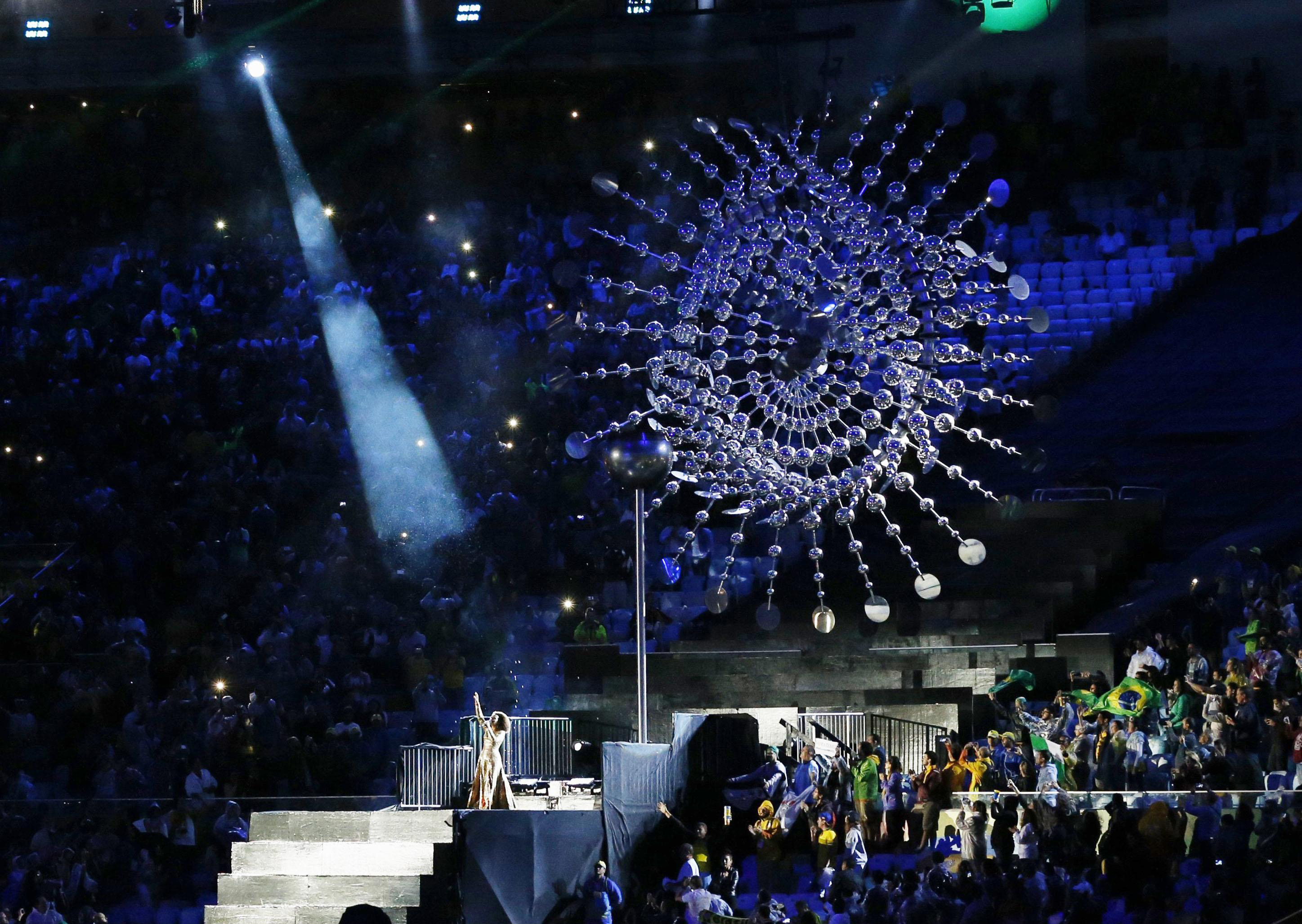 The Olympic flame is extinguished at the end of the Rio Olympics' closing ceremony on Sunday. |  KYODO