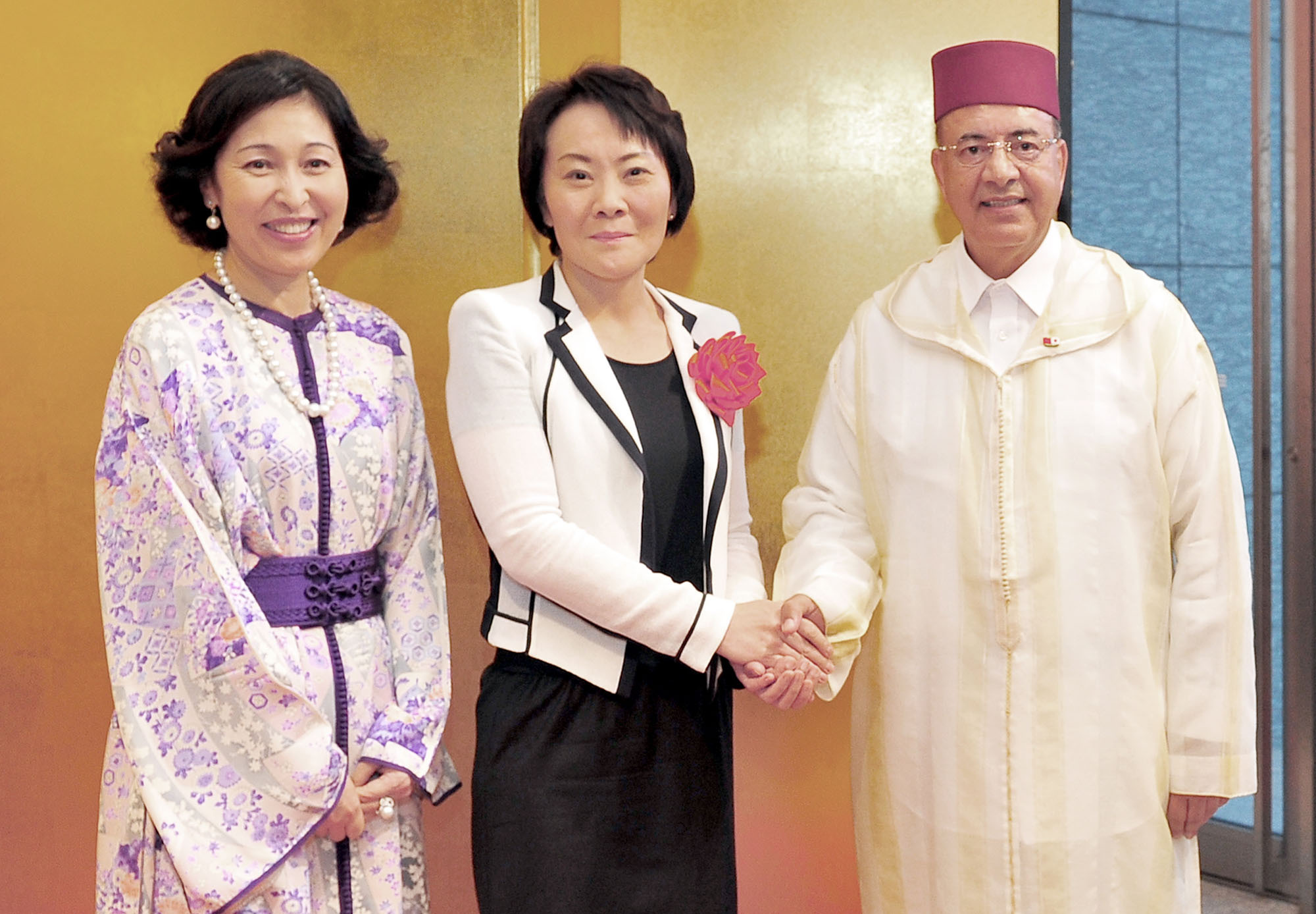 Moroccan Ambassador Samir Arrour (right) and his wife Utako welcome Miki Yamada (center), parliamentary vice minister for foreign affairs, during a reception to celebrate the 17th anniversary of the enthronement of King Mohammed VI and the 60th anniversary of the establishment of diplomatic relations between the kingdom and Japan at Palace Hotel in Tokyo on Aug. 1. | YOSHIAKI MIURA