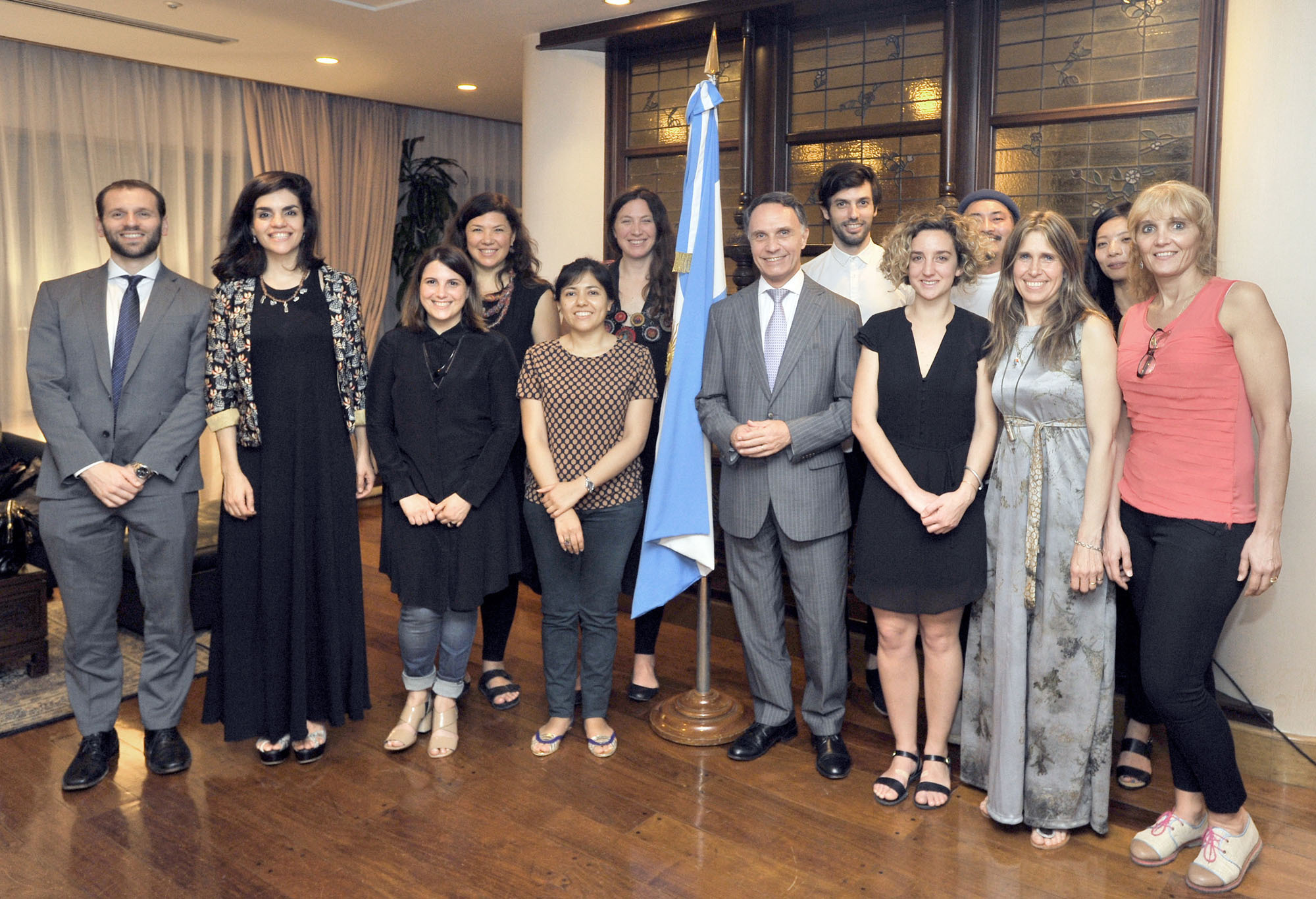 "Nine Argentine designers pose with Argentina's Ambassador Alan Beraud (front row, fourth from right) and Second Secretary, Economic Commercial Affairs Department, Ivan da Ponte (left) at a cocktail party for the ""Rooms"" fashion and design trade show (Sept. 14-16) at the ambassador's residence in Tokyo on Sept. 14. 