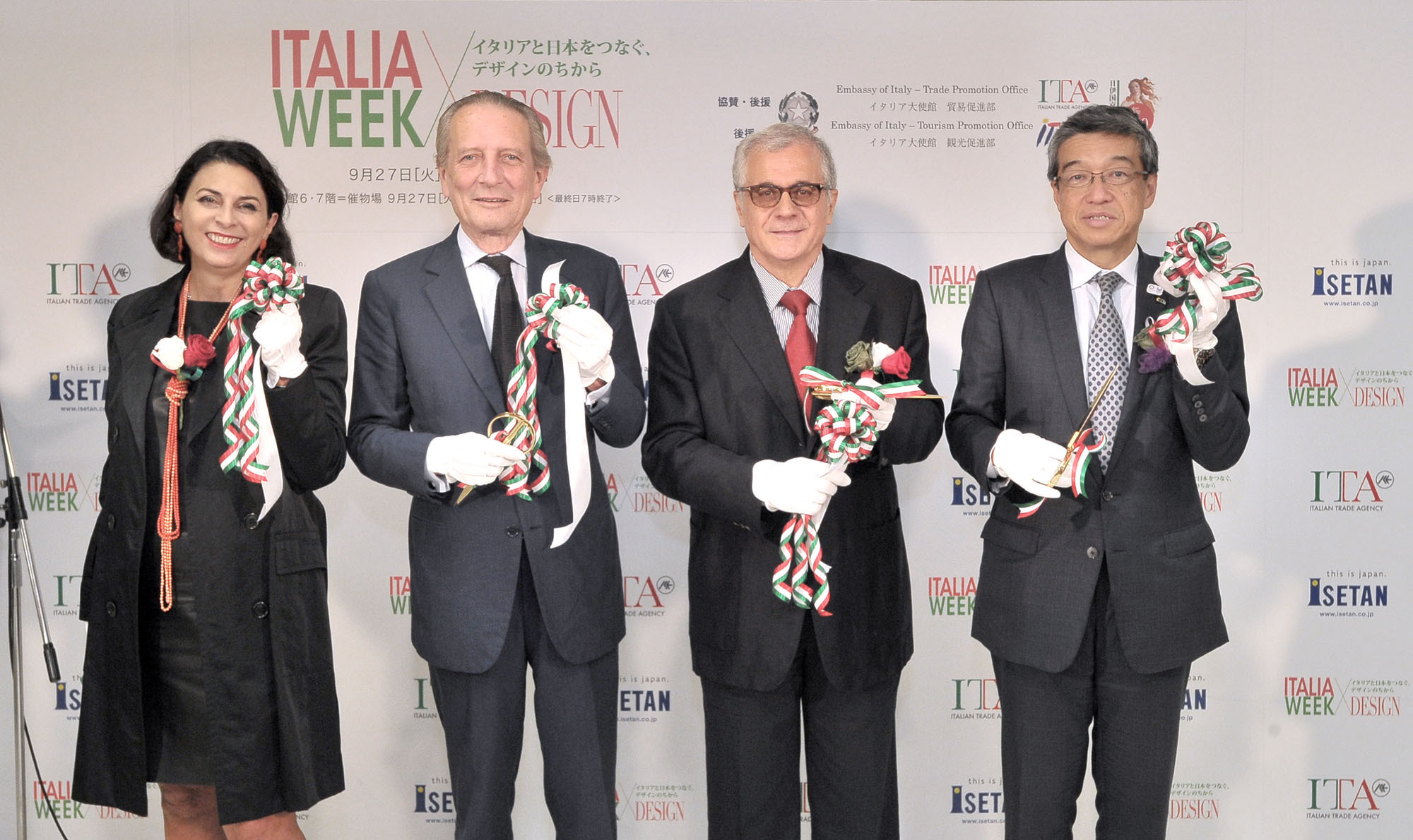 "Italy's Ambassador Domenico Giorgi (second from left) and his wife, Rita Mannella-Giorgi pose with the Head of the Italian Trade Agency's Trade Promotion Office, Aristide Martellini (second from right), and Hiroshi Ohnishi, president & C.E.O. of Isetan Mitsukoshi Holdings. Ltd. at the ribbon-cutting ceremony for ""ITALIA WEEK,"" which celebrates the 150th anniversary of diplomatic Relations between Japan and Italy and Isetan's 130th anniversary, at the Isetan Shinjuku Main Building on Sept. 27. 