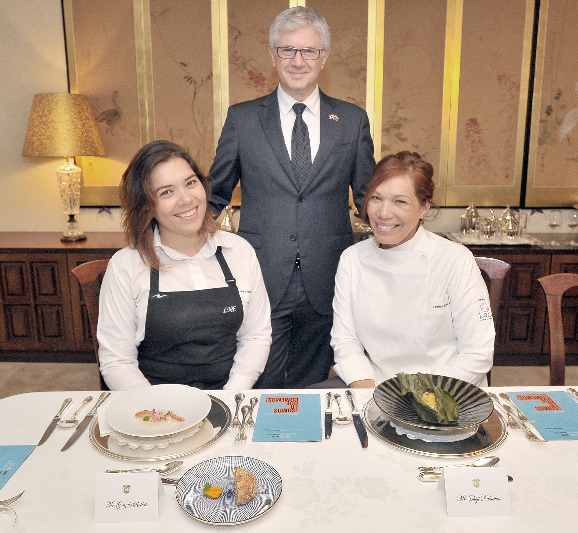 Visiting Colombian Chef Leonor Espinosa (right) and sommelier Laura Hernandez Espinosa (left) pose with Colombia's Ambassador Gabriel Duque while promoting Colombian cuisine during a luncheon event at the ambassador's residence in Tokyo on Oct. 5. | YOSHIAKI MIURA