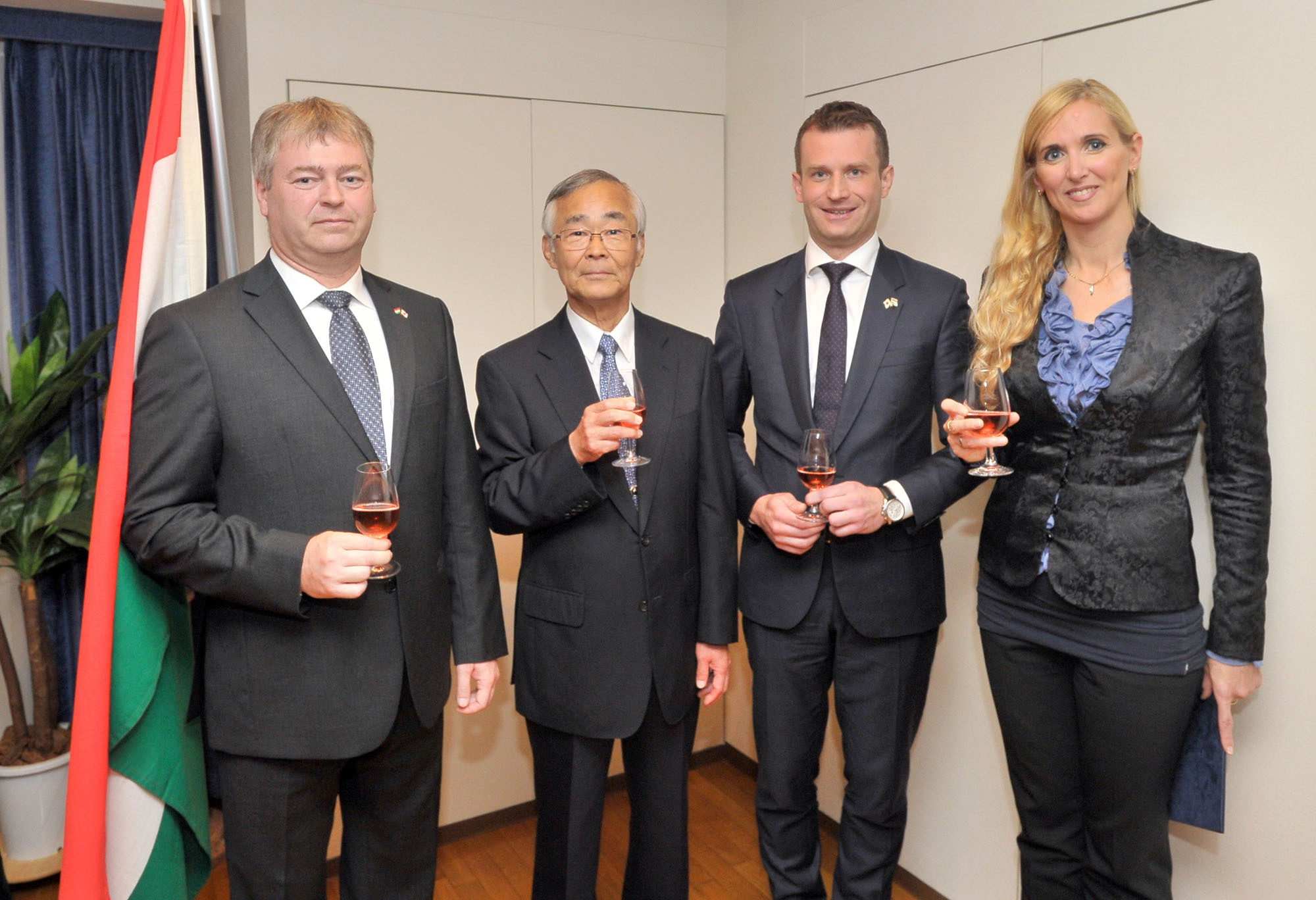 From left, Charge d'affaires of Hungary Attila Erdos joins Chairman of the Japan-Hungary Friendship Association Shinichi Nabekura; Hungary's Ambassador-designate Norbert Palanovics; and Hungary's State Secretary for Sports Tunde Szabo during a National Day reception at the embassy in Tokyo on Oct. 21. |  YOSHIAKI MIURA