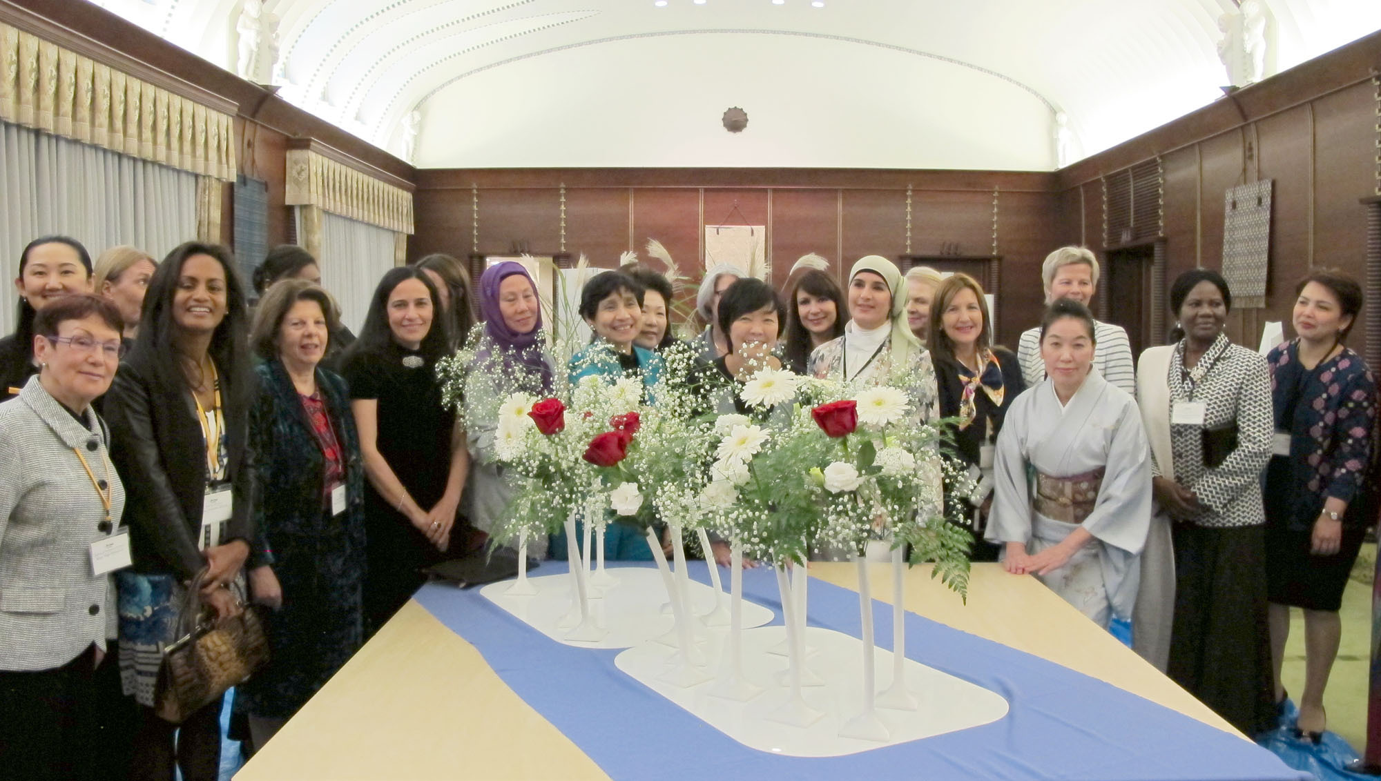 First lady Akie Abe is joined by ambassadors and ambassadors' spouses from 23 countries at an Ikebana International event that aims to promote international friendship through flowers at the prime minister's official residence on Nov. 9. | IKEBANA INTERNATIONAL