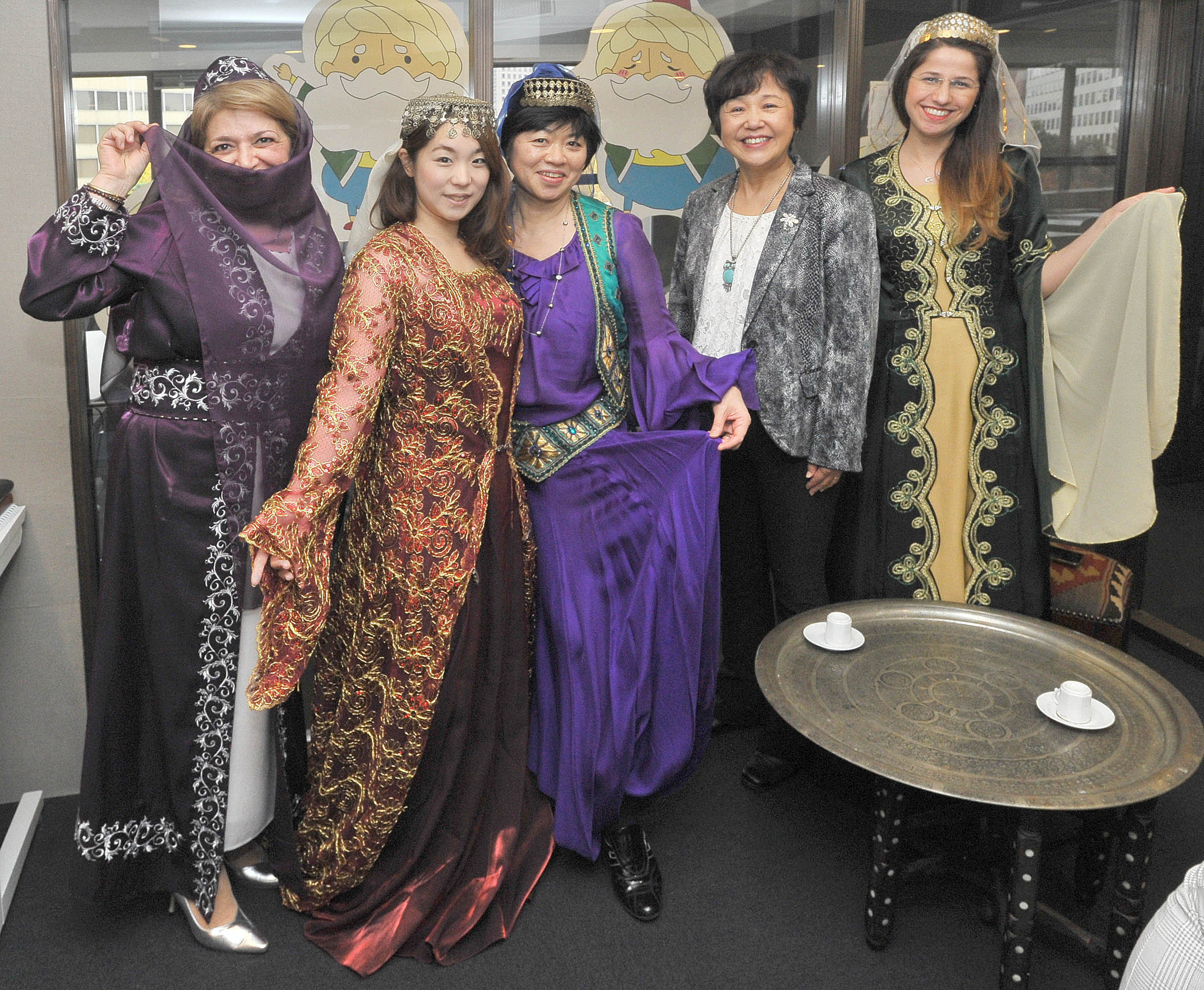 Kumiko Meric (second from right), the wife of Turkey's ambassador to Japan, and Japan-Turkish Womens Club members pose with people in traditional Turkish folk costumes at a celebration of Turkish culture, organized by the Japan-Turkish Womens Club, at Yunus Emre Institute in Tokyo on Nov. 27. | YOSHIAKI MIURA