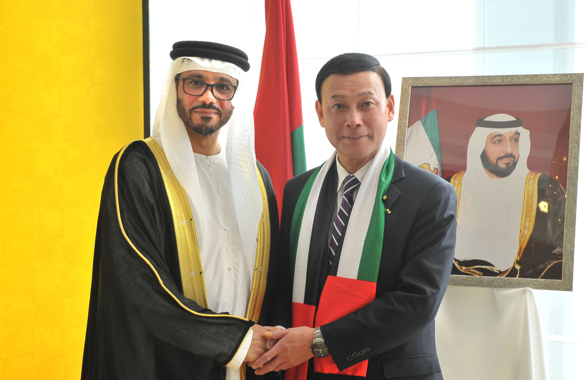 UAE Ambassador Khaled Alameri (left) shakes hands with Parliamentary Vice-Minister for Foreign Affairs Motome Takisawa, during a reception celebrating the 45th anniversary of UAE national day at the Palace Hotel Tokyo on Dec. 1. | YOSHIAKI MIURA