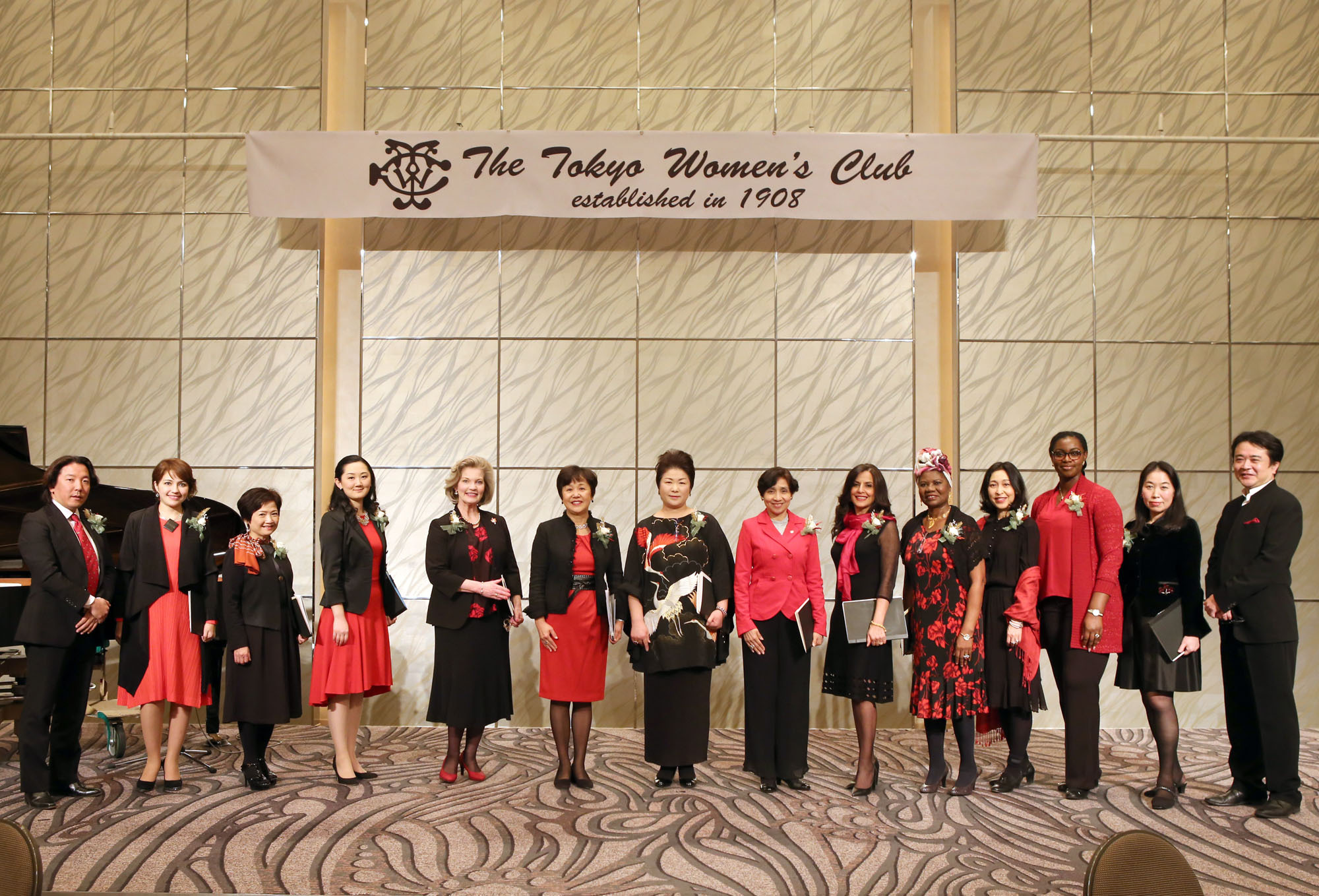The Beyond  Borders Choir, composed of diplomats and their relatives from Cameroon, Denmark, El Salvador, Micronesia, Morocco, Palestine, Panama, Turkey, Venezuela and Vietnam, pose with musicians and event organizers following a concert aimed at promoting peace, harmony and prosperity at a charity Christmas party hosted by the Tokyo Women's Club at the Cerulean Tower Tokyu Hotel on Dec. 13. |  VIETNAM EMBASSY