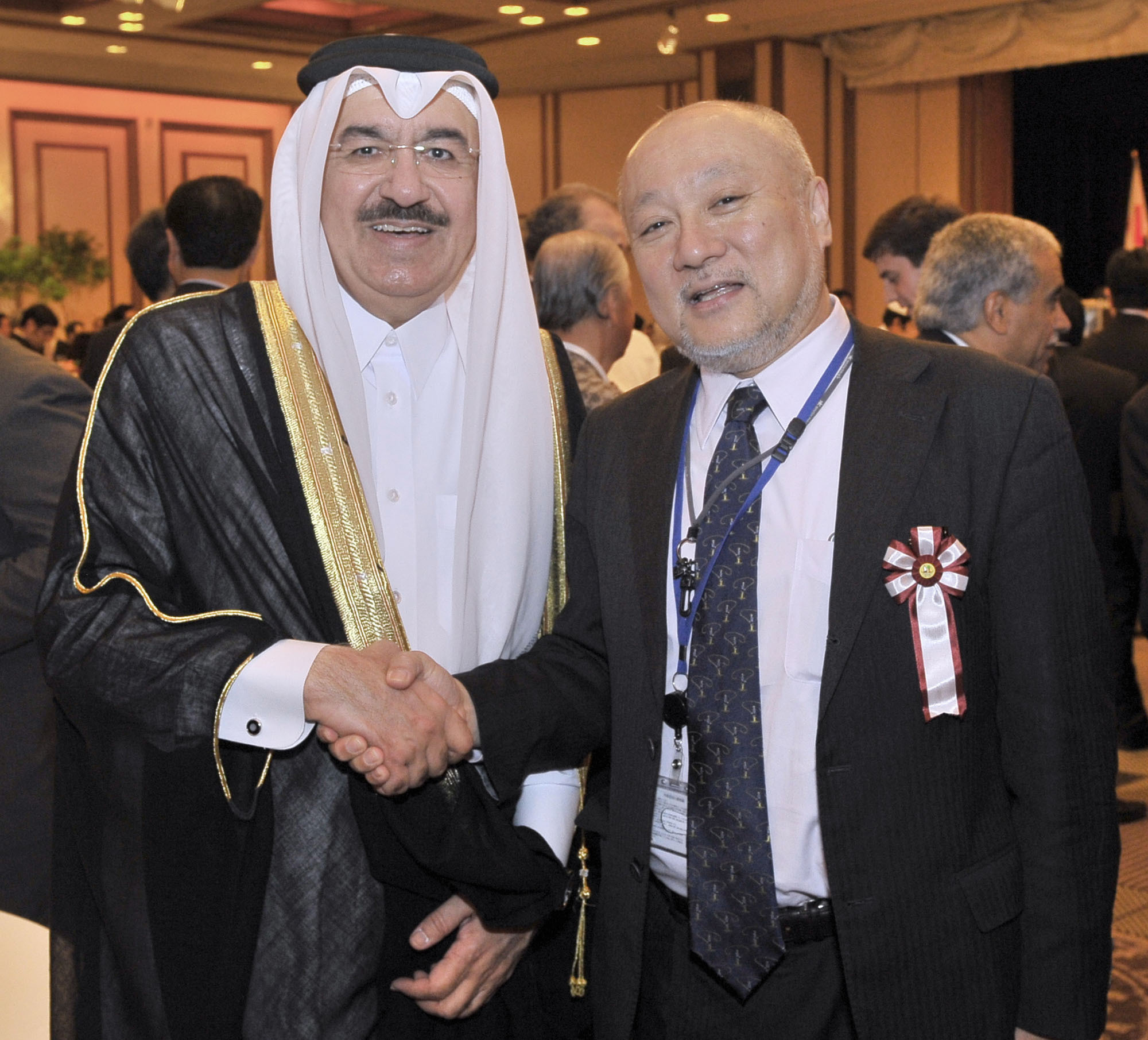 Qatar's Ambassador Yousef Mohamed Bilal (left) greets the Ministry of Foreign Affairs Director-General of the Middle Eastern and African Affairs Bureau Tsukasa Uemura at a reception to celebrate the National Day of the State of Qatar at the Imperial Hotel, Tokyo, on Dec. 13. | YOSHIAKI MIURA