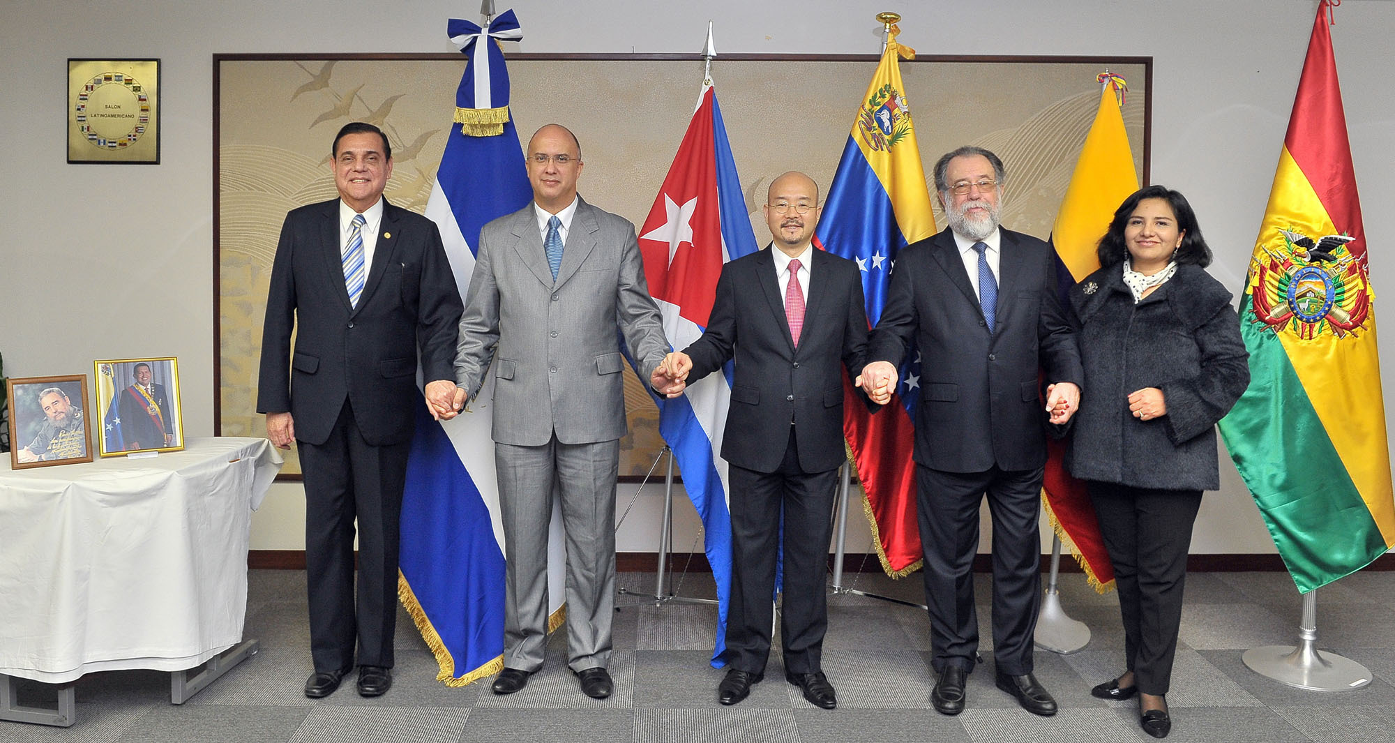 From left, Nicararagua's Ambassador, Saul Arana Castellon; Cuba's Ambassador Carlos M. Pereira; Venezuela's Ambassador Seiko Ishikawa; Ecuador's Ambassador Leonardo Carrion; and Bolivia's Charge d'Affaires a.i. Angela Ayllon join hands during a reception to celebrate of the 12th anniversary of the foundation of the Bolivarian Alliance for the Peoples of Our America at the Latin American Salon, in Tokyo's Minato Ward on Dec. 22. | YOSHIAKI MIURA