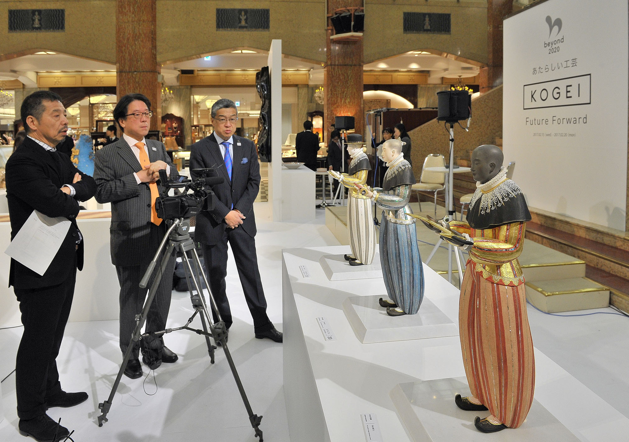 "(From left) Tokyo University of the Arts professor Yuji Akimoto; Secretary-General of the Secretariat of the Headquarters for the Tokyo 2020 Olympic and Paralympic Games Takeo Hirata; and President and CEO of Isetan Mitsukoshi Holdings. Ltd. Hiroshi Ohnishi attend a preview of the ""KOGEI Future Forward"" exhibition, which runs through Feb. 20, at the Nihombashi Mitsukoshi Main Building on Feb. 15. 
