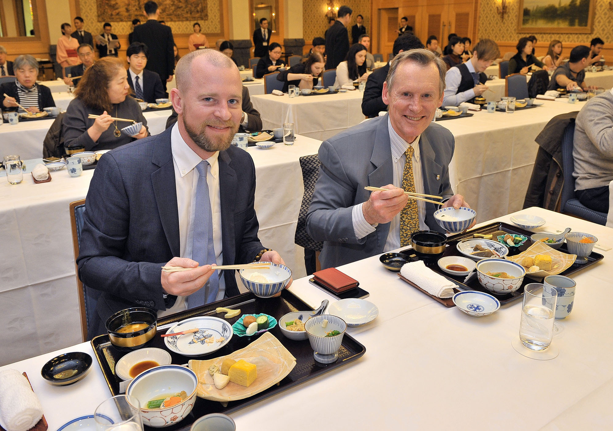 Members of the foreign press eat wachoshoku, traditional Japanese breakfast, while receiving an etiquette lesson at the Hotel Okura in Tokyo on Feb. 16. | YOSHIAKI MIURA
