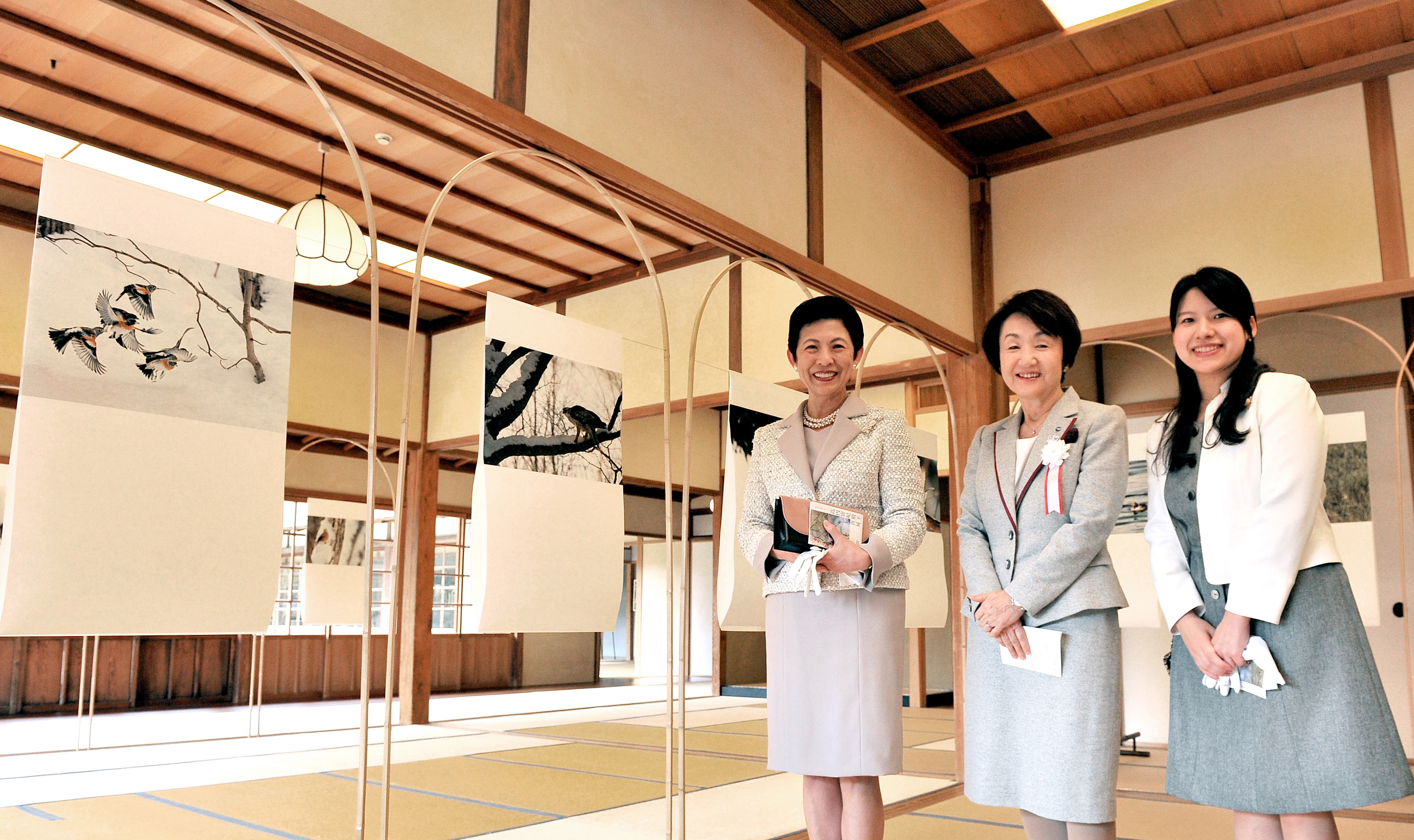 "Princess Takamado (left) poses with her daughter Princess Ayako (right) and Yokohama Mayor Fumiko Hayashi at the Kakushokaku building in Yokohama's Sankeien Garden during an opening ceremony on Feb. 28 for ""Gleam of Birds III,"" an exhibition that runs through March 6 featuring 54 bird photographs taken by Princess Takamado. 