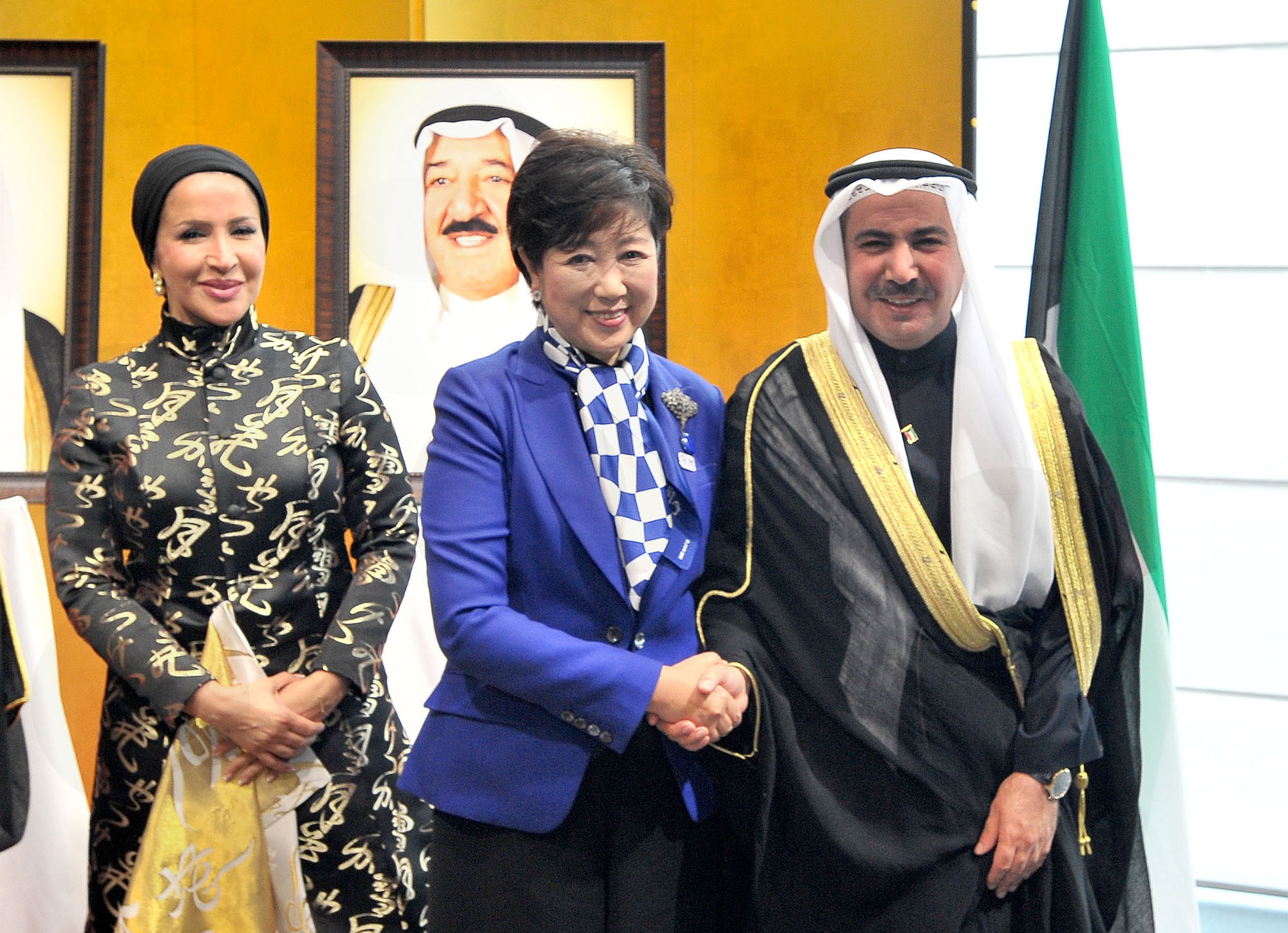 Kuwait's Ambassador Abdul Rahman Humood Al-Otaibi (right) and his wife Jamila (left) welcome Tokyo Gov. Yuriko Koike to a reception celebrating the 56th Kuwait national day and 26th anniversary of the liberation of Kuwait at the Palace Hotel on Feb. 23. | YOSHIAKI MIURA