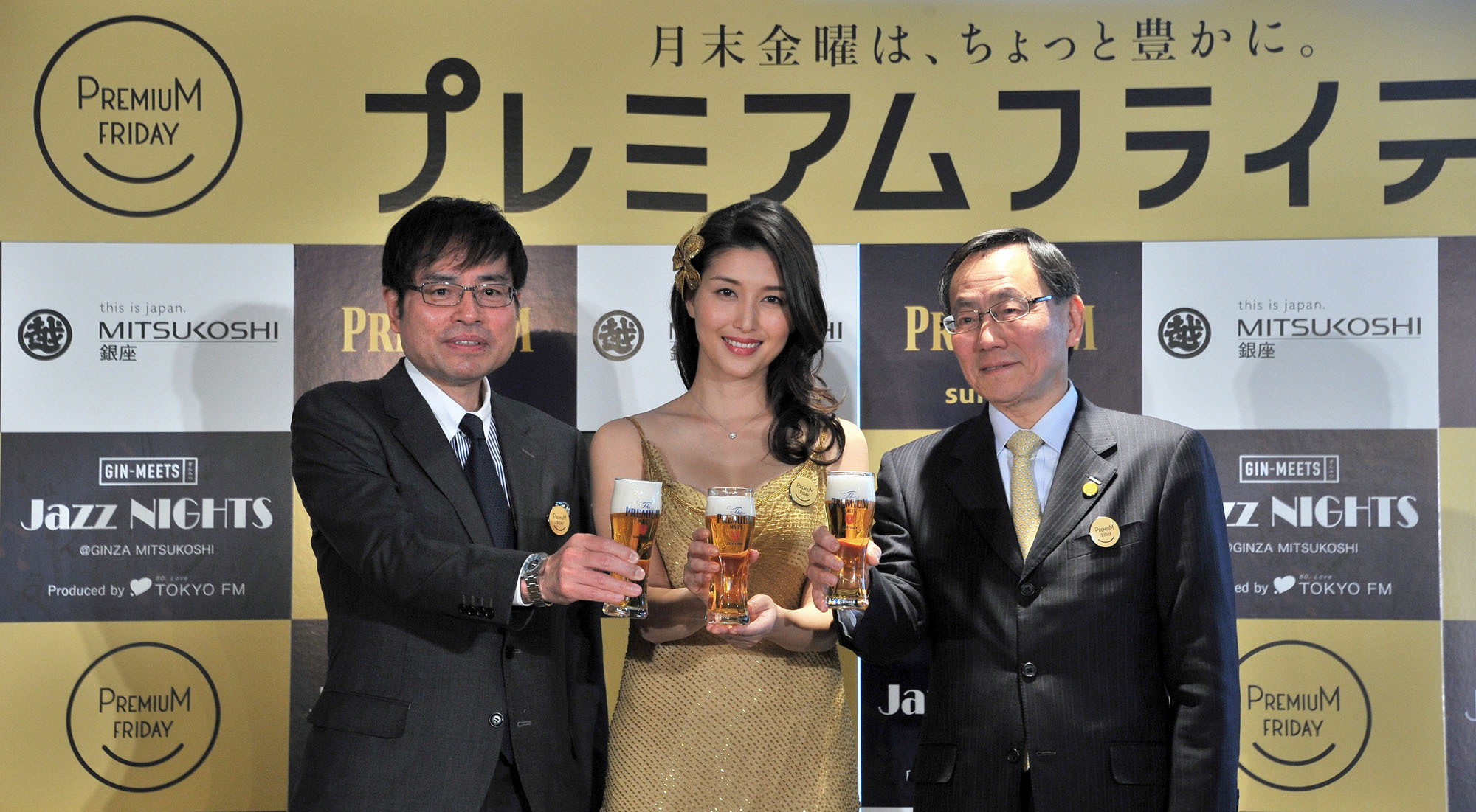 From left: Executive Officer and General Manager of Mitsukoshi Ginza Makoto Asaka raises a glass with actress Manami Hashimoto and Vice President of Suntory Holdings Ltd. Yasunori Aiba at Mitsukoshi's Premium Friday opening ceremony at Mitsukoshi Ginza on Feb. 24. | YOSHIAKI MIURA