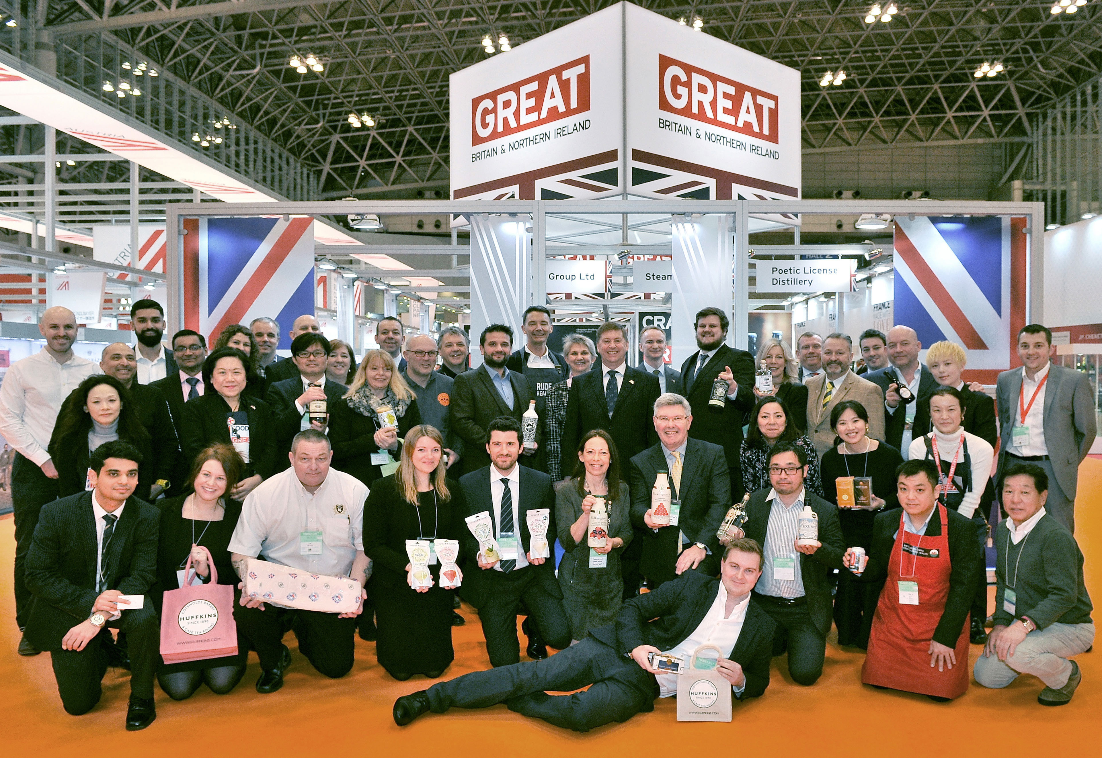 Attendees and exhibitors, including British Ambassador Paul Madden, CMG, and his wife Sarah, pose in front of the Britain and Northern Ireland booth at the Foodex Japan 2017 opening ceremony at Makuhari Messe in Chiba Prefecture on March 7. | YOSHIAKI MIURA