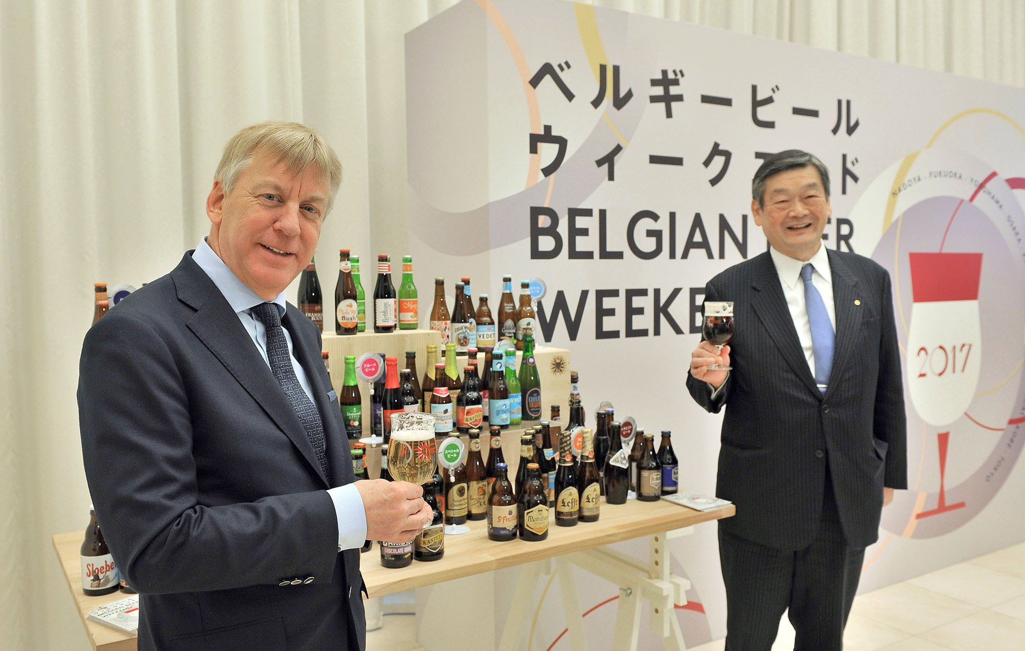 Belgium's Ambassador Gunther Sleeuwagen (left), honorary chairman of the Belgian Beer Weekend committee, raises his glass with Konishi Brewing Co. President and Chairman of the committee Shintaro Konishi at a news conference to promote Belgian Beer Weekend 2017 at the Belgian embassy in Tokyo on March 16. Belgium Beer Weekend kicks off in Nagoya on April 26 before moving to seven other cities and ending in Tokyo on Sept. 18. | YOSHIAKI MIURA