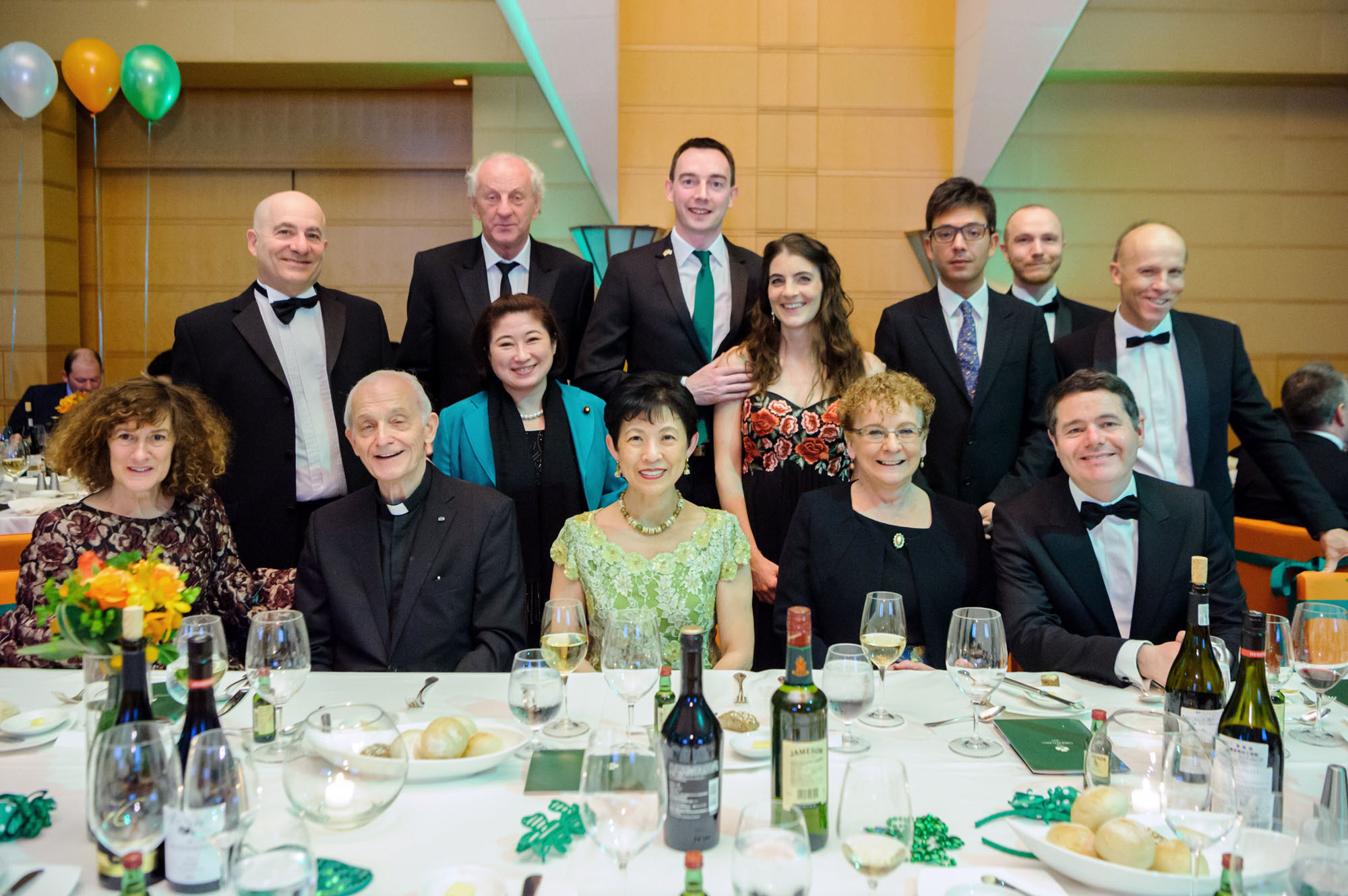 Princess Takamado (front row, center), Irish Ambassador Anne Barrington (front row, second from right), Irish Minister for Public Expenditure and Reform Paschal Donohoe (front row, right) and other guests pose at the Emerald Ball, which raises money for three charities, at the Tokyo American Club, on March 18. | ANTONY TRAN