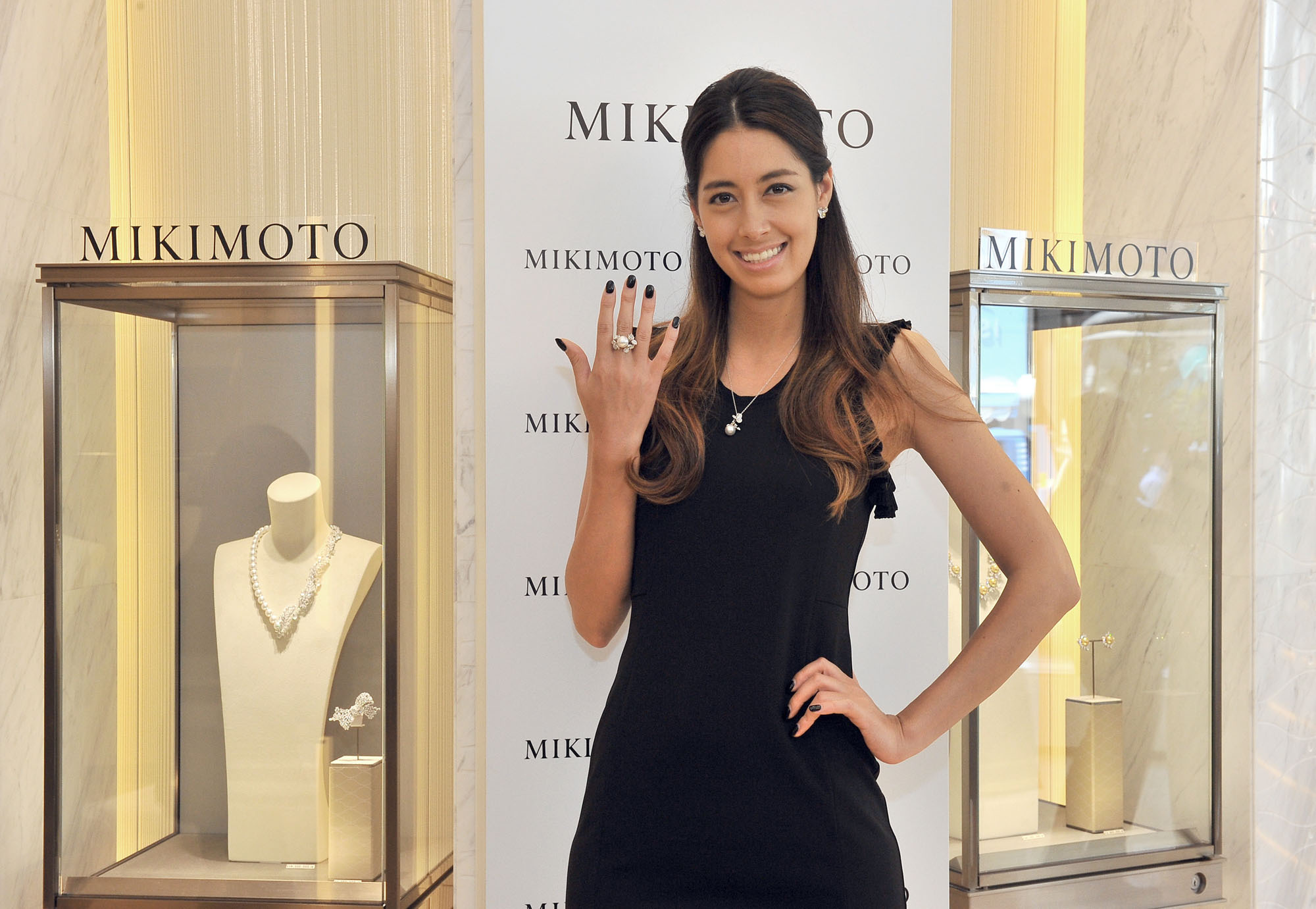 Model Izumi Mori poses with a ring at a press preview of the opening of Mikimoto's main store in Ginza on May 30. |  YOSHIAKI MIURA