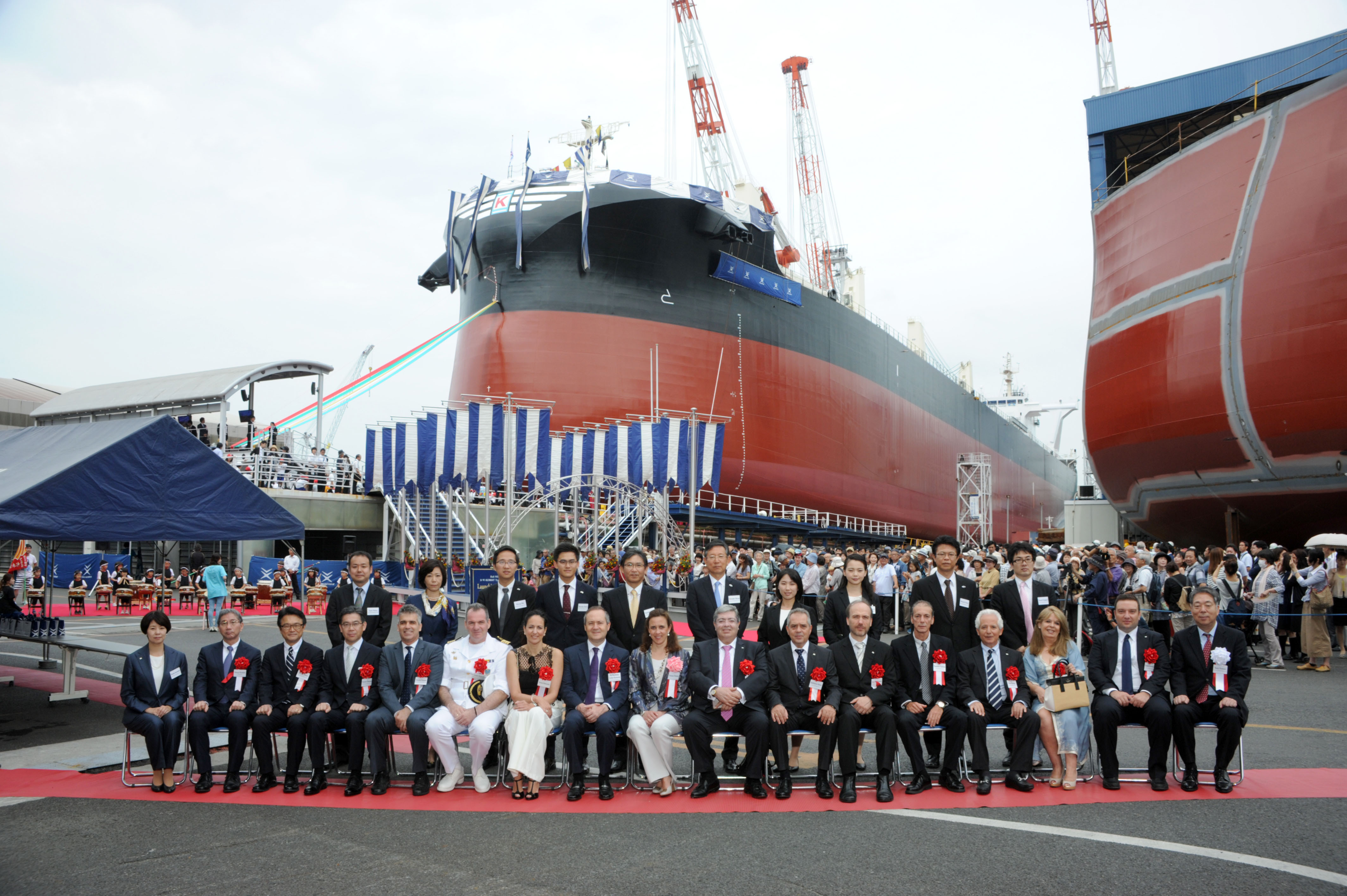 Guests pose for a photograph before Tsuneishi Shipbuilding Co., Ltd. launches a 63,700-ton vessel in celebration of its 100th anniversary on June 26 in the city of Fukuyama in Hiroshima Prefecture. | COURTESY OF TSUNEISHI SHIPBUILDING CO., LTD.