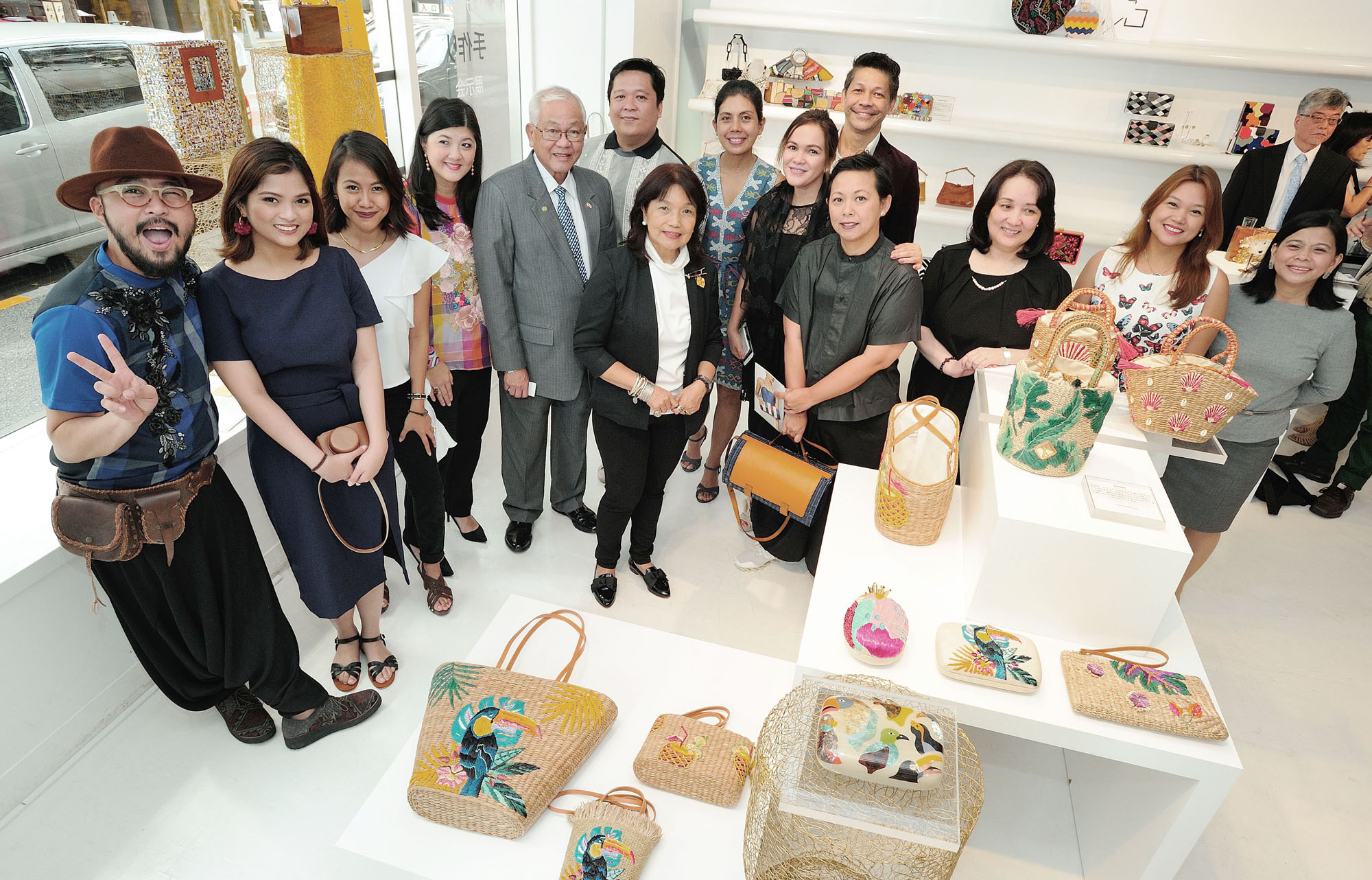 Philippines Ambassador Jose C. Laurel V (fifth from left) poses for a photo during the opening ceremony of the Philippine Design Exhibition at Good Design Marunouchi on Sept. 11. The event runs through Sept. 24. |  YOSHIAKI MIURA