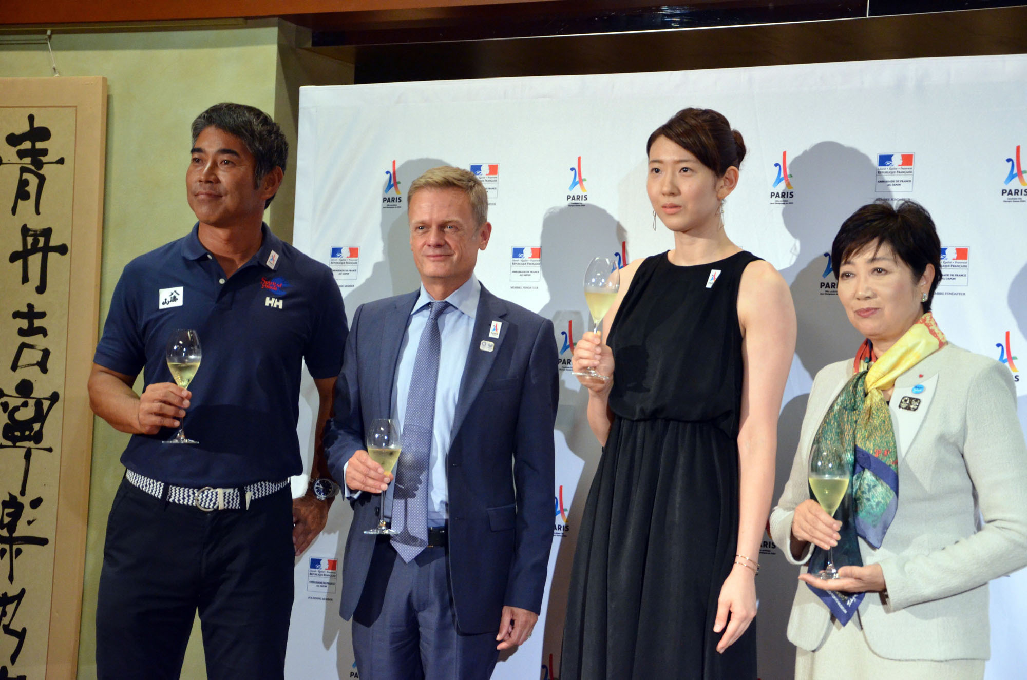 French Ambassador Laurent Pic (second from left) and Tokyo Gov. Yuriko Koike (right) pose for a photograph with Olympic athletes Kojiro Shiraishi (left) and Yukiko Ebata (second from right) at a reception in Tokyo on Sept. 14 following an announcement that Paris had been selected to host the 2024 Olympics. |  COURTESY OF THE FRENCH EMBASSY