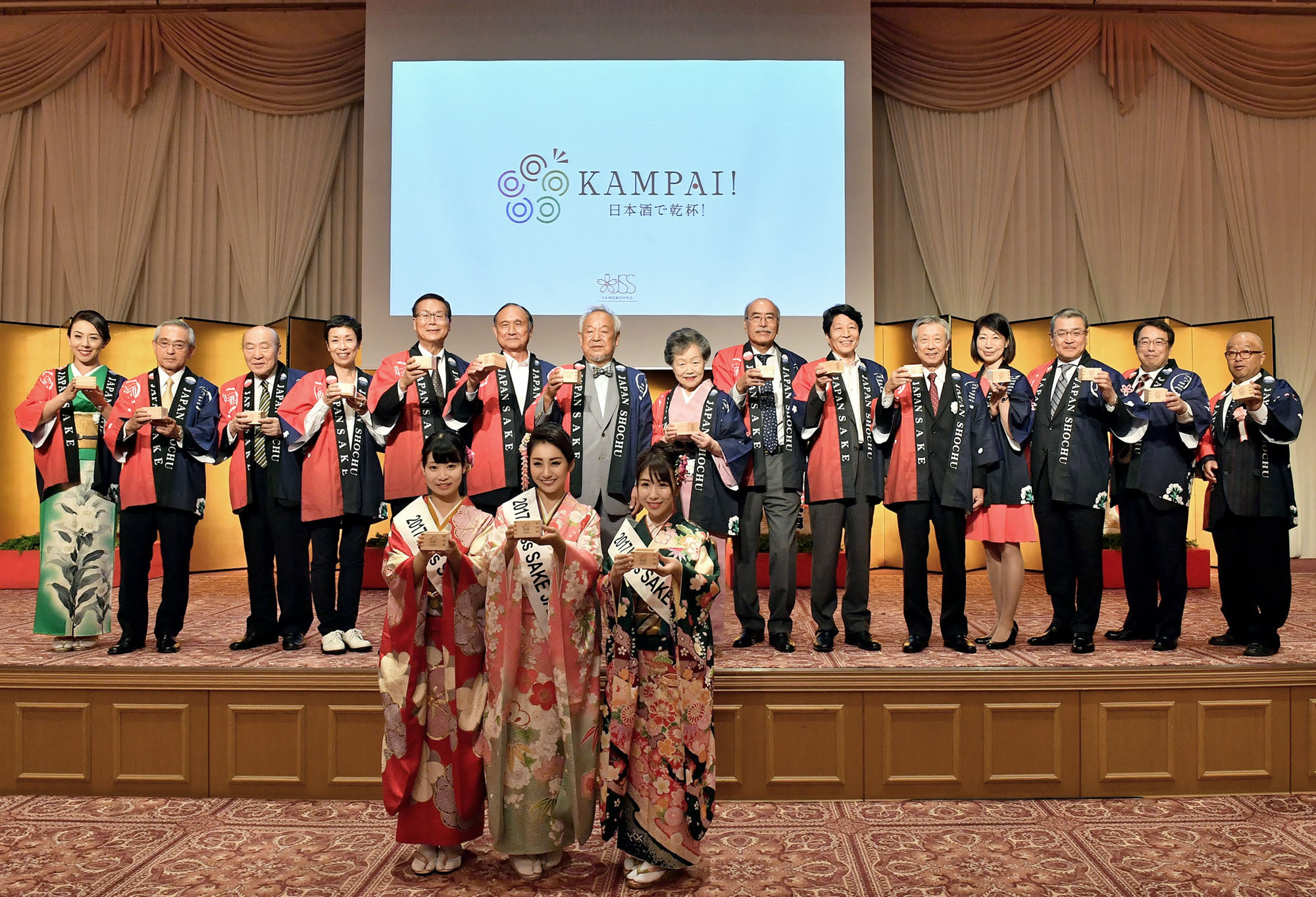 """Sake promotional group members raise a toast with masu-zake (sake served in traditional wooden boxes) at an event held at Meiji Kinenkan to advertise the """"Let's kampai together with sake!'' campaign during  """"October 1st is Sake Day"""" celebrations.    YOSHIAKI MIURA"""