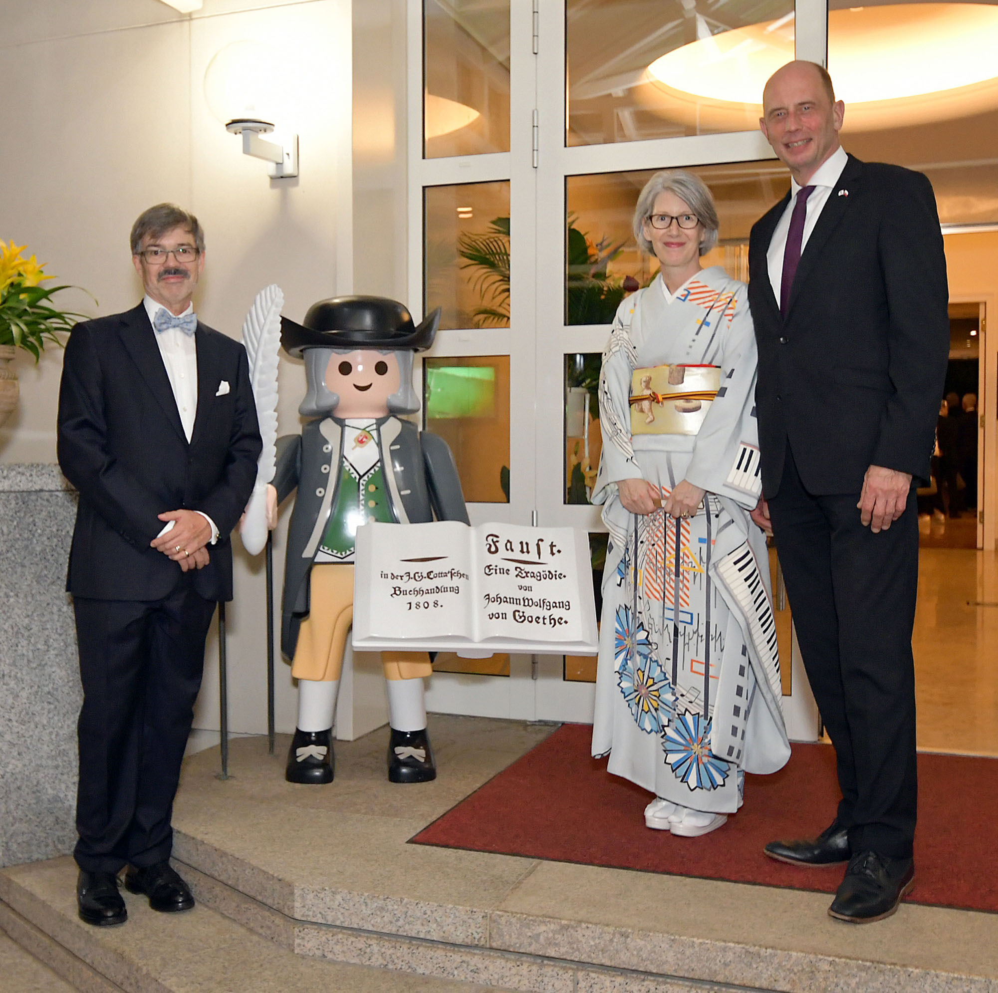 German Ambassador Hans Carl von Werthern (left) and his wife, Elizabeth, pose with Wolfgang Tiefensee, Thuringian Minister for Economic Affairs, Science and Digital Society, during a reception to celebrate the Day of German Unity at the ambassadorial residence in Tokyo on Oct. 3. |   COURTESY OF THE GERMAN EMBASSY