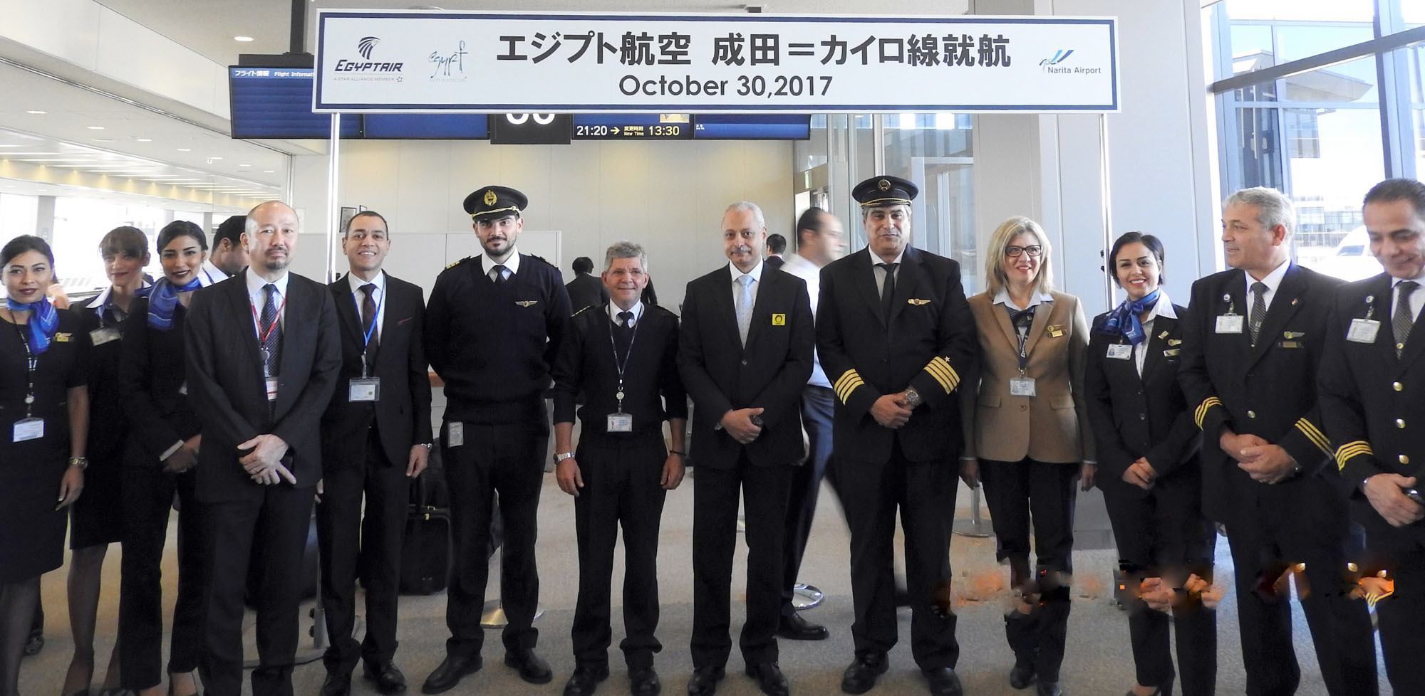 Egyptian Ambassador Ayman Kamel (center) poses with EgyptAir staff at Narita Airport on Oct. 30 during a ceremony to mark the resumption of flights between Cairo and Tokyo. |   COURTESY OF EGYPTIAN EMBASSY