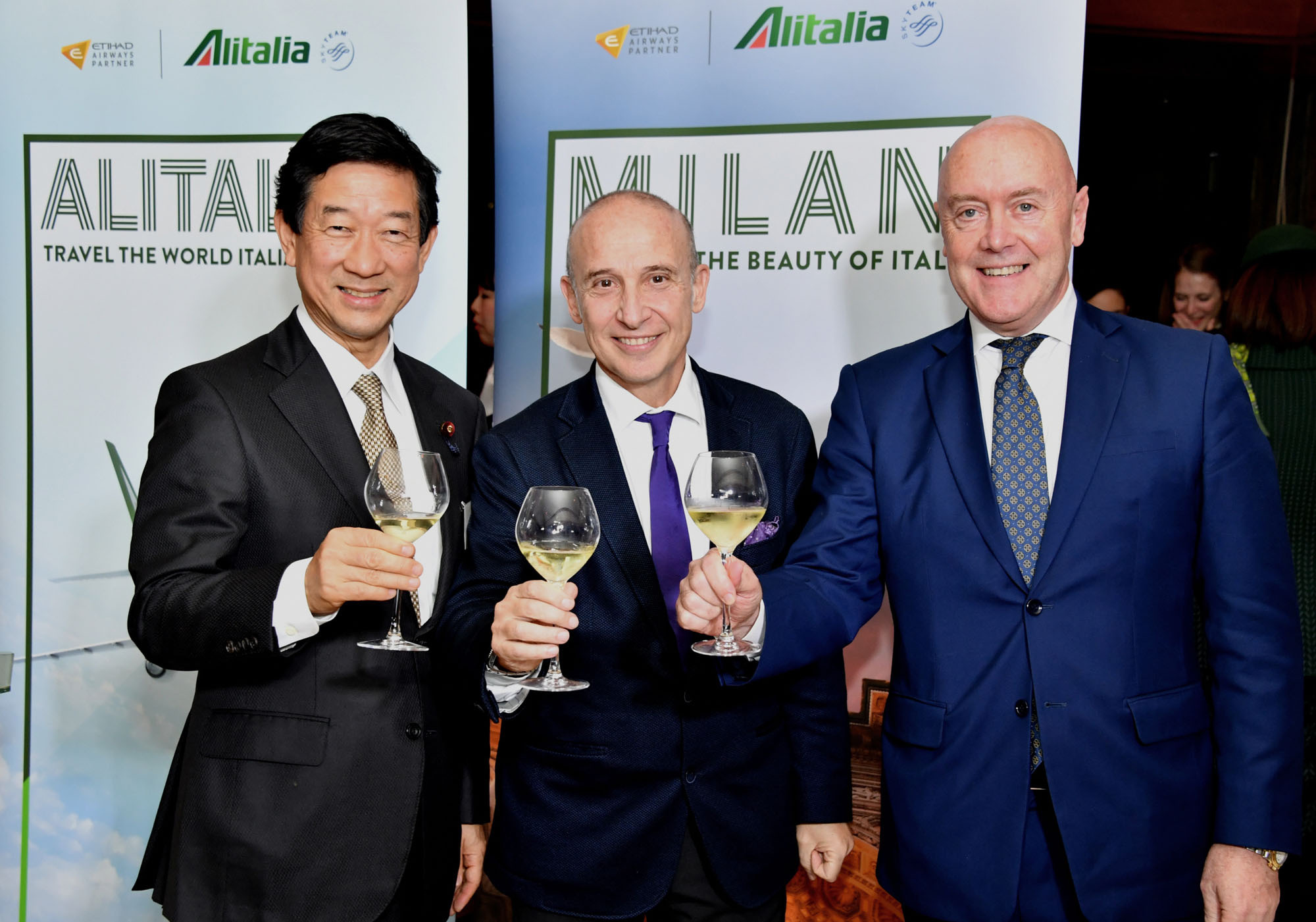 Alitalia Regional General Manager for Asia-Pacific Massimo Allegri (right) joins Italian Ambassador Giorgio Starace (center) and Lower House lawmaker Shintaro Ito during a reception to celebrate the 70th anniversary of the airline's first national flight at the Italian ambassador's residence in Tokyo on Tuesday. |  YOSHIAKI MIURA