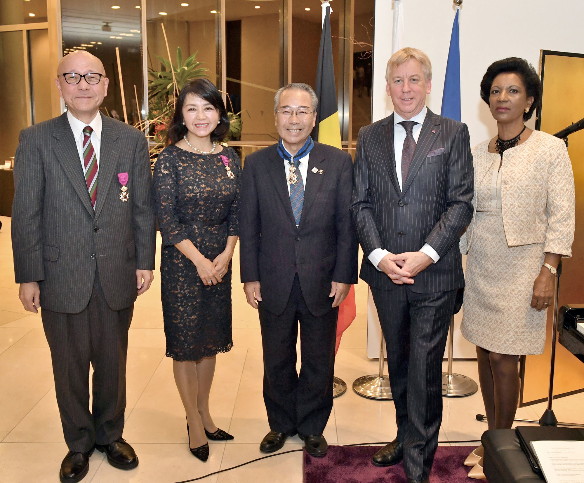Belgian Ambassador Gunther Sleeuwagen (second from right) and his wife, Rahel (right), pose for a photo with (from left) officer of the order of Leopold recipients Jiro Okuyama and Misuzu Iwami, who are both vice-grand master of ceremonies at the Imperial Household Agency,  and commander of the order of Leopold II recipient Yuki Mayor Fumio Zemba during a reception to celebrate King's Day on Nov. 17. |  YOSHIAKI MIURA