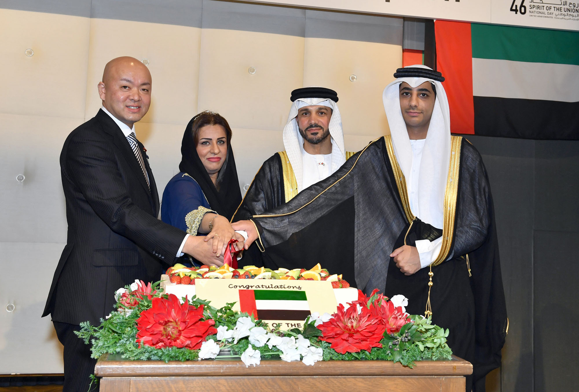 United Arab Emirates Ambassador Khaled Alameri (second from right) cuts a cake during a ceremony to celebrate the country's national day at Palace Hotel Tokyo on Nov. 27. Alameri is photographed with (from left) Manabu Horii, parliamentary vice-minister of foreign affairs, First Secretary Fatima Jumah Mohammed Aldhmani and Second Secretary Suood Ebrahim Leamash. |  YOSHIAKI MIURA