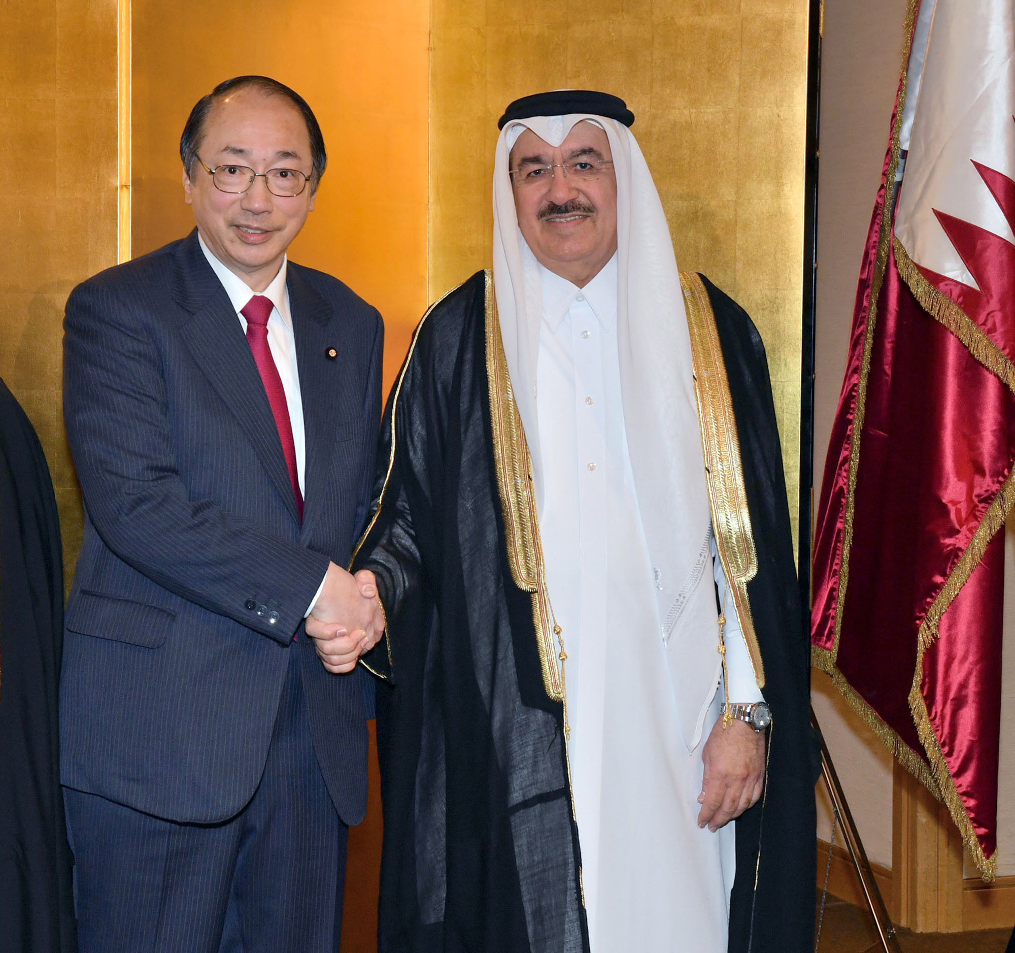 Qatar Ambassador Yousef Mohamed Bilal (right) welcomes Environment Minister Masaharu Nakagawa during a reception to celebrate the Qatar's national day at Imperial Hotel on Dec. 13. |   YOSHIAKI MIURA