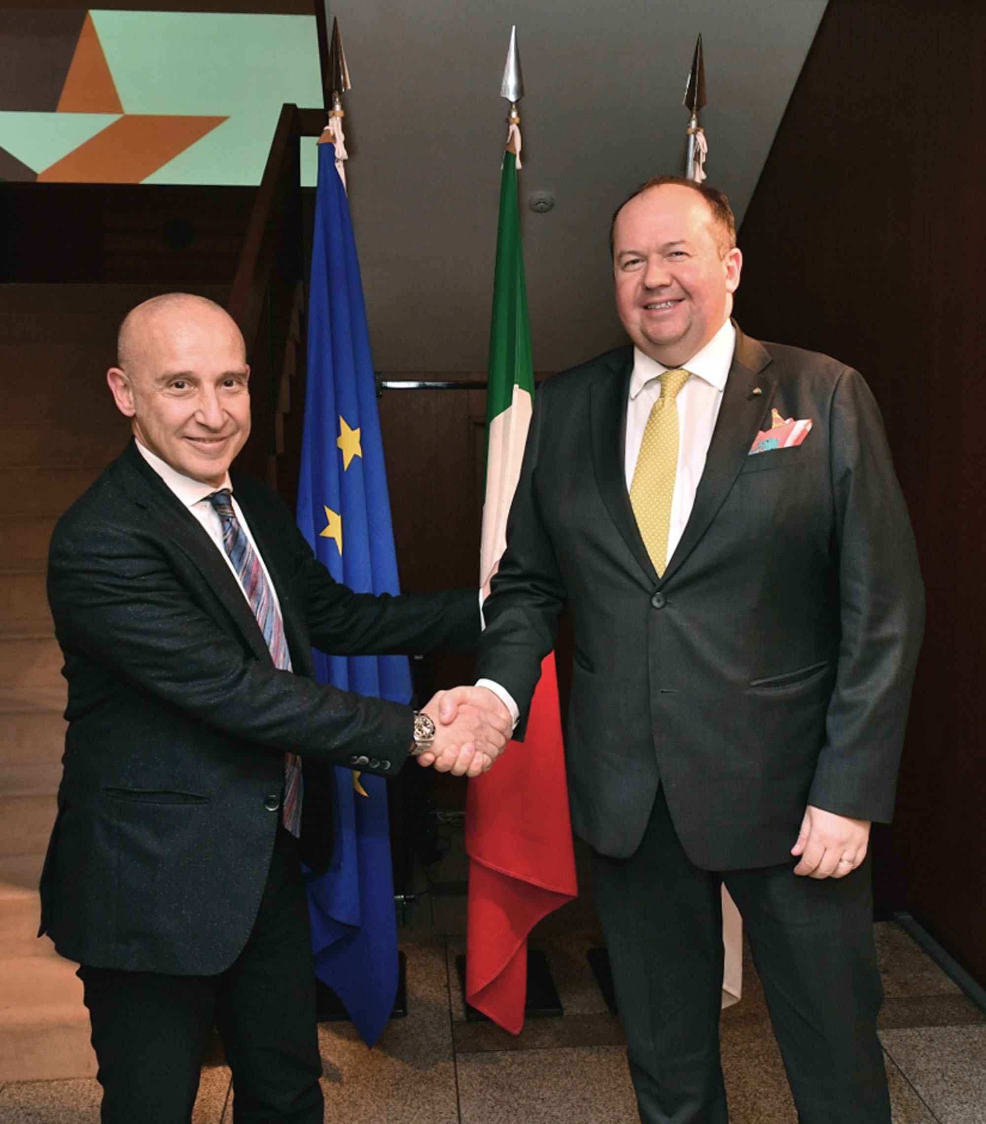 Italian Ambassador Giorgio Starace (left) shakes hand Antonello Mordeglia, president & CEO of Danieli Automation, during a reception to celebrate the 10th anniversary of Danieli Engineering Japan at the ambassador's residence in Tokyo on Jan. 24. |   YOSHIAKI MIURA