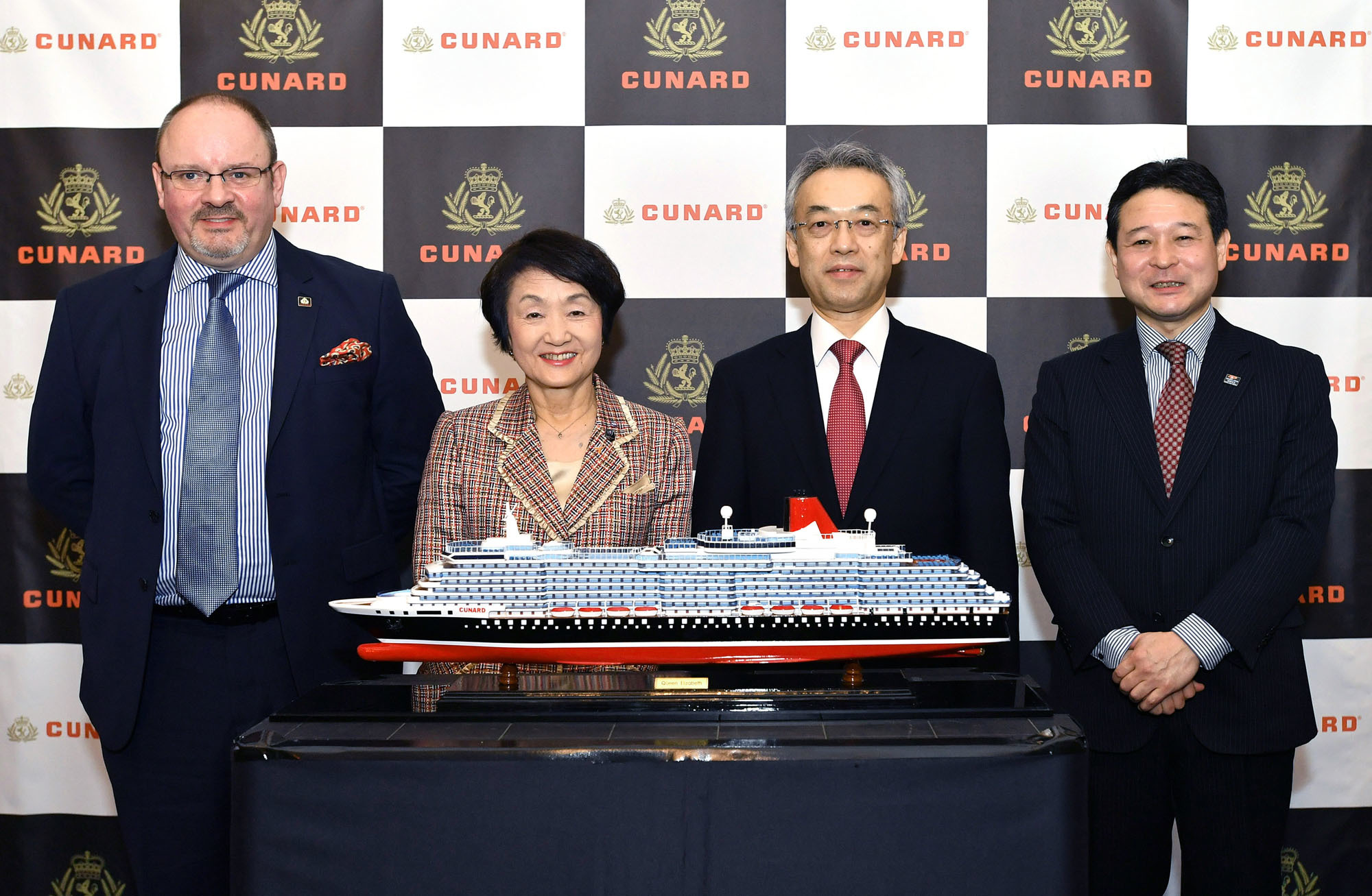"Cunard Line Japan Director Tokumasa Kojima (right) poses with (from left) Bob Dixon, director of Cunard's European, Middle Eastern, Asian and Latin American operations; Yokohama Mayor Fumiko Hayashi; and Michio Kikuchi, director-general of the Ports and Harbors Bureau under the Ministry of Land, Infrastructure, Transport and Tourism at the British ambassador' s residence during the unveiling of the timetable of the ""2020 Queen Elizabeth"" cruise on March 9. 