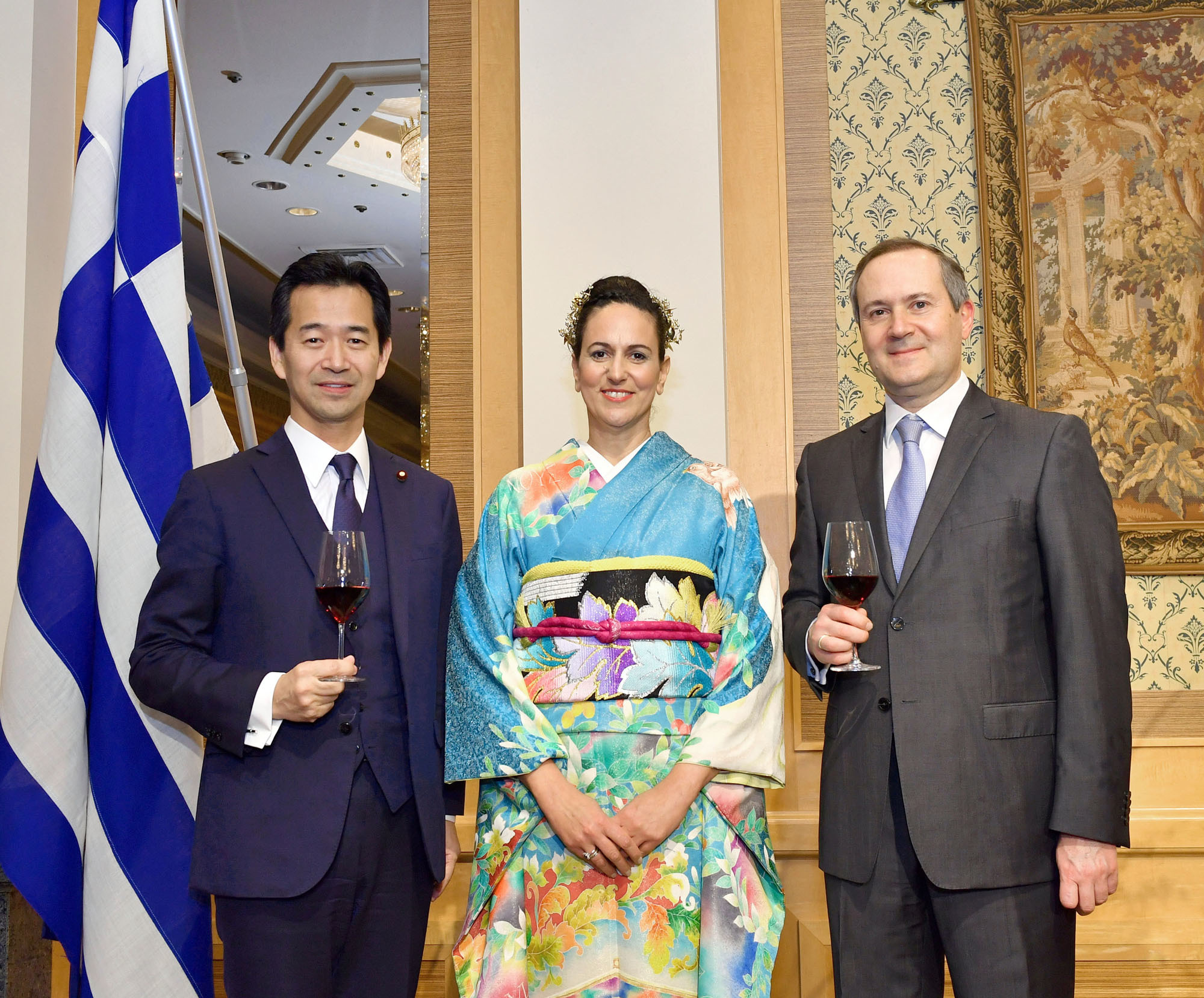 The Ambassador of Greece Loukas Karatsolis (right) and his wife, Katerina (center), welcome Parliamentary Vice-Minister for Foreign Affairs Mitsunari Okamoto during a reception to celebrate of the National Day of Greece at Hotel Okura Tokyo on March 23. |   YOSHIAKI MIURA